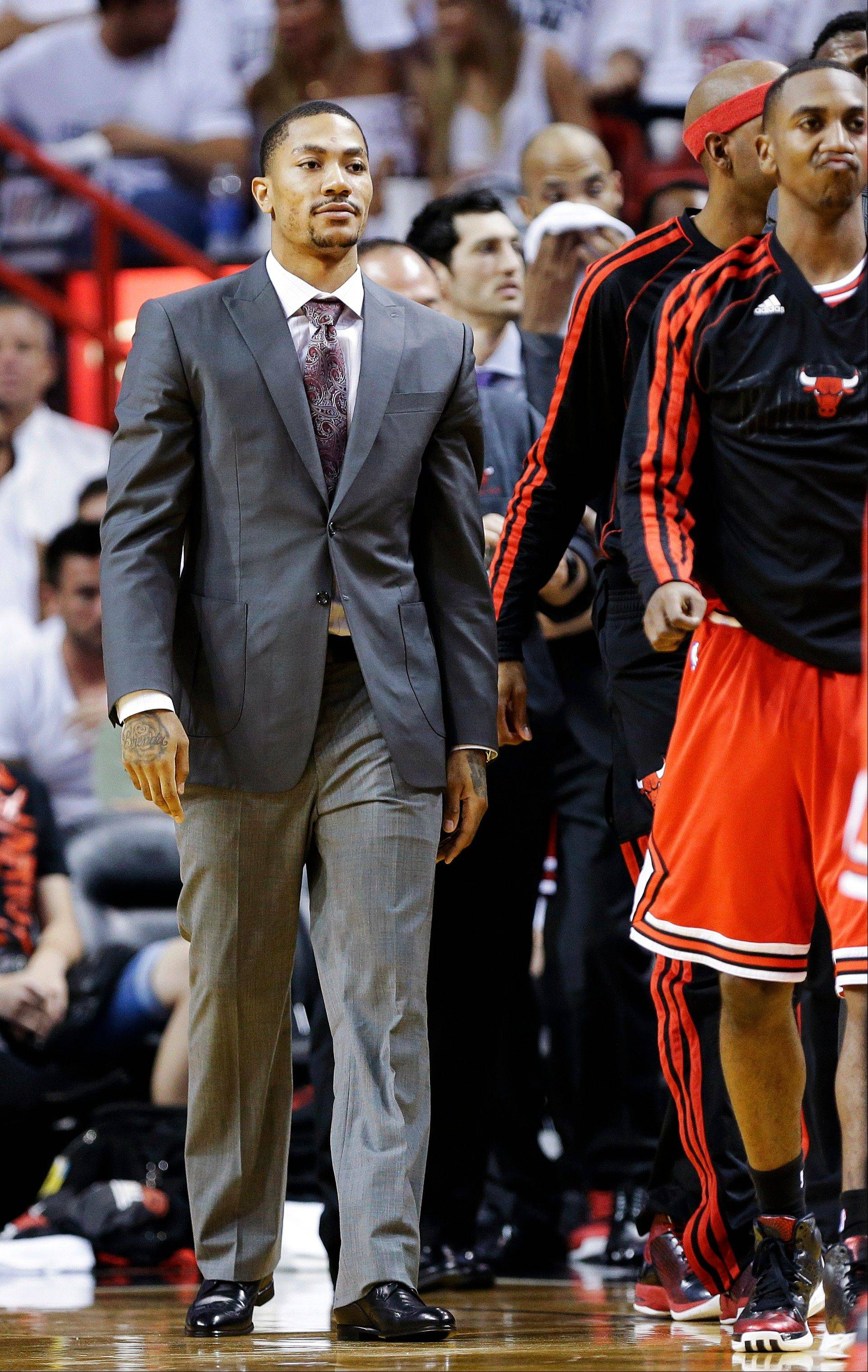 Chicago Bulls guard Derrick Rose walks on the sideline during the first half of Game 1 of the NBA basketball playoff series in the Eastern Conference semifinals against the Miami Heat, Monday, May 6, 2013 in Miami. Rose has not played while recovering from reconstructive knee surgery.