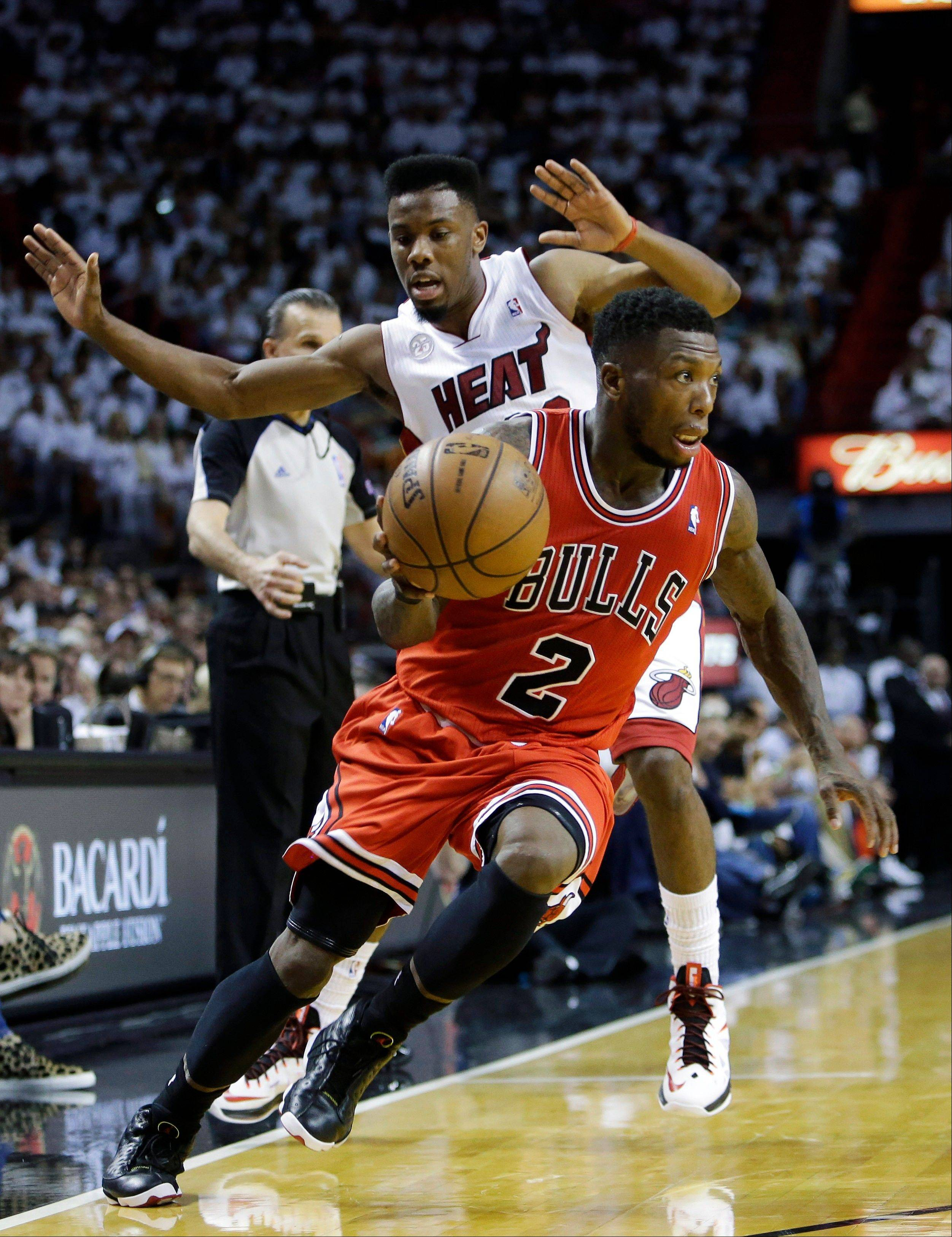 Chicago Bulls guard Nate Robinson (2) drives to the basket past Miami Heat guard Norris Cole during the second half of Game 1 of the NBA basketball playoff series in the Eastern Conference semifinals, Monday, May 6, 2013 in Miami. Robinson scored 27 points as the Bulls defeated the Heat 93-86.