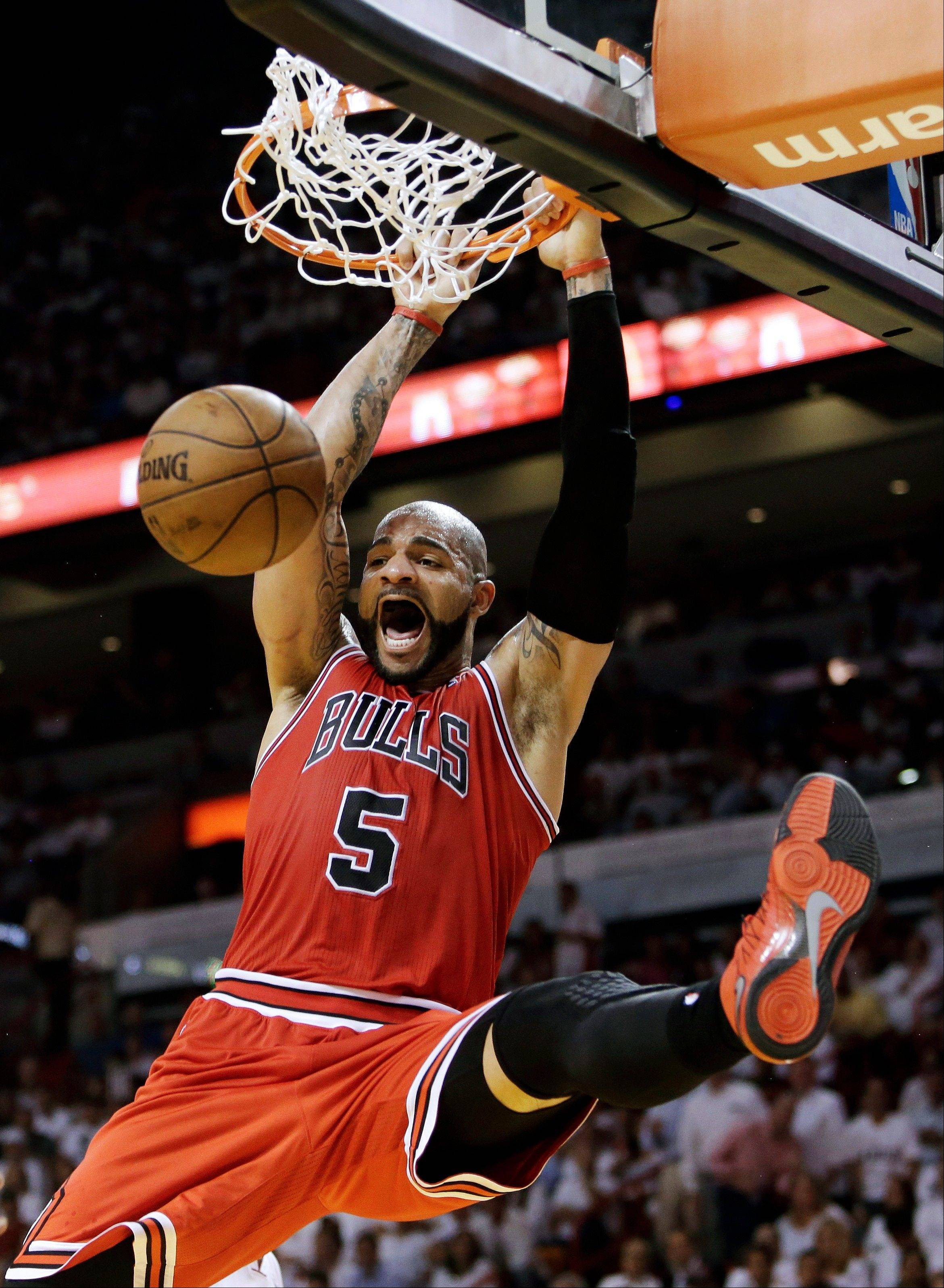 Chicago Bulls forward Carlos Boozer dunks during the second half of Game 1 of the NBA basketball playoff series in the Eastern Conference semifinals against the Miami Heat, Monday, May 6, 2013 in Miami.