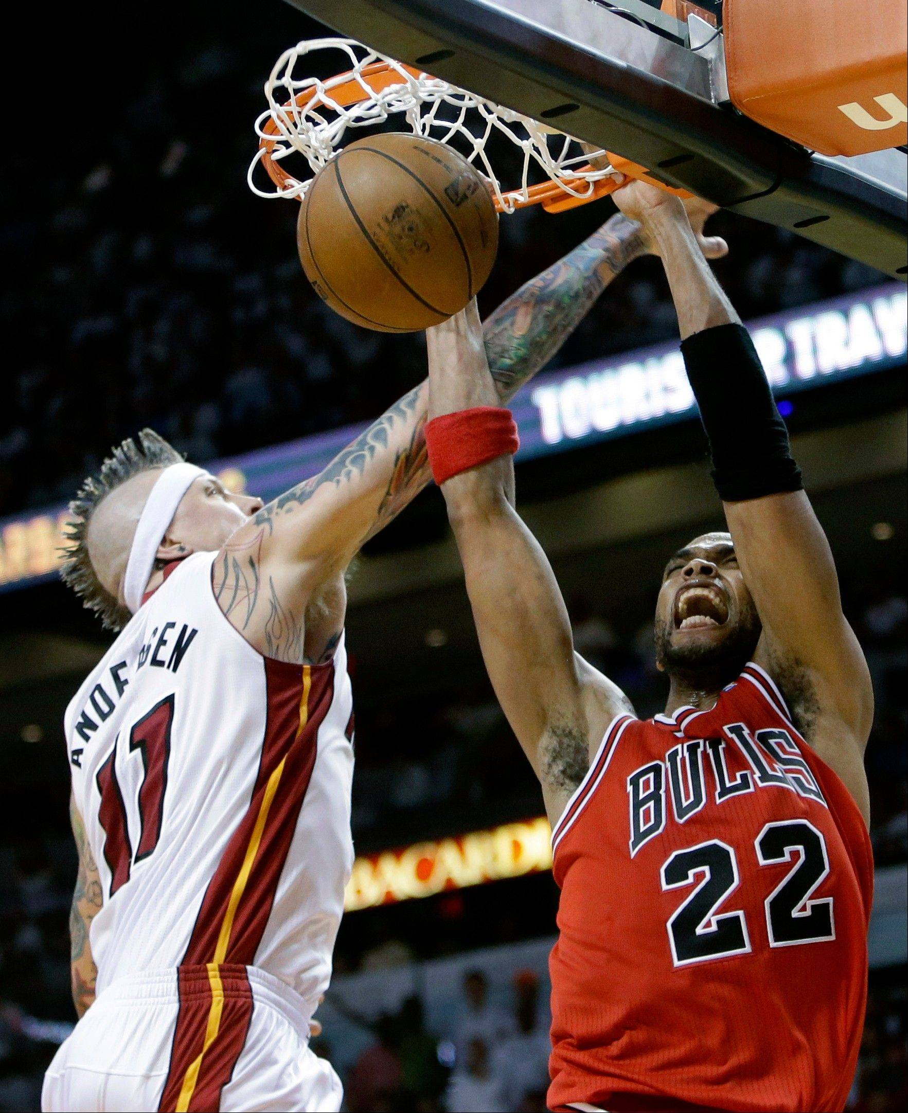 Chicago Bulls forward Taj Gibson (22) dunks against Miami Heat forward Chris Andersen (11) during the second half of Game 1 of the NBA basketball playoff series in the Eastern Conference semifinals, Monday, May 6, 2013 in Miami. The Bulls defeated the Heat 93-86.