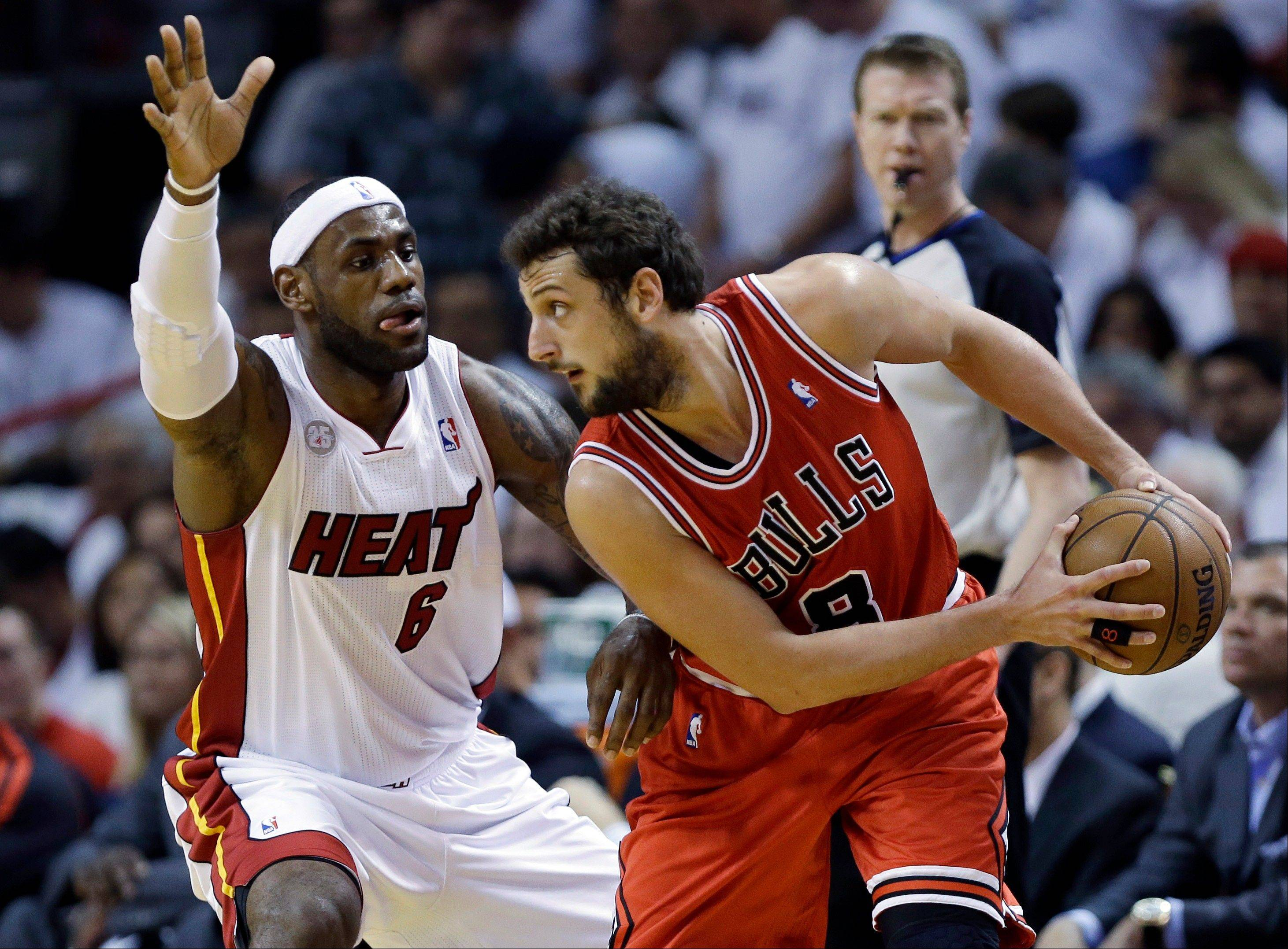 Chicago Bulls guard Marco Belinelli (8), of Italy, looks for an open teammate past Miami Heat forward LeBron James (6) during the first half of Game 1 of the NBA basketball playoff series in the Eastern Conference semifinals, Monday, May 6, 2013 in Miami.