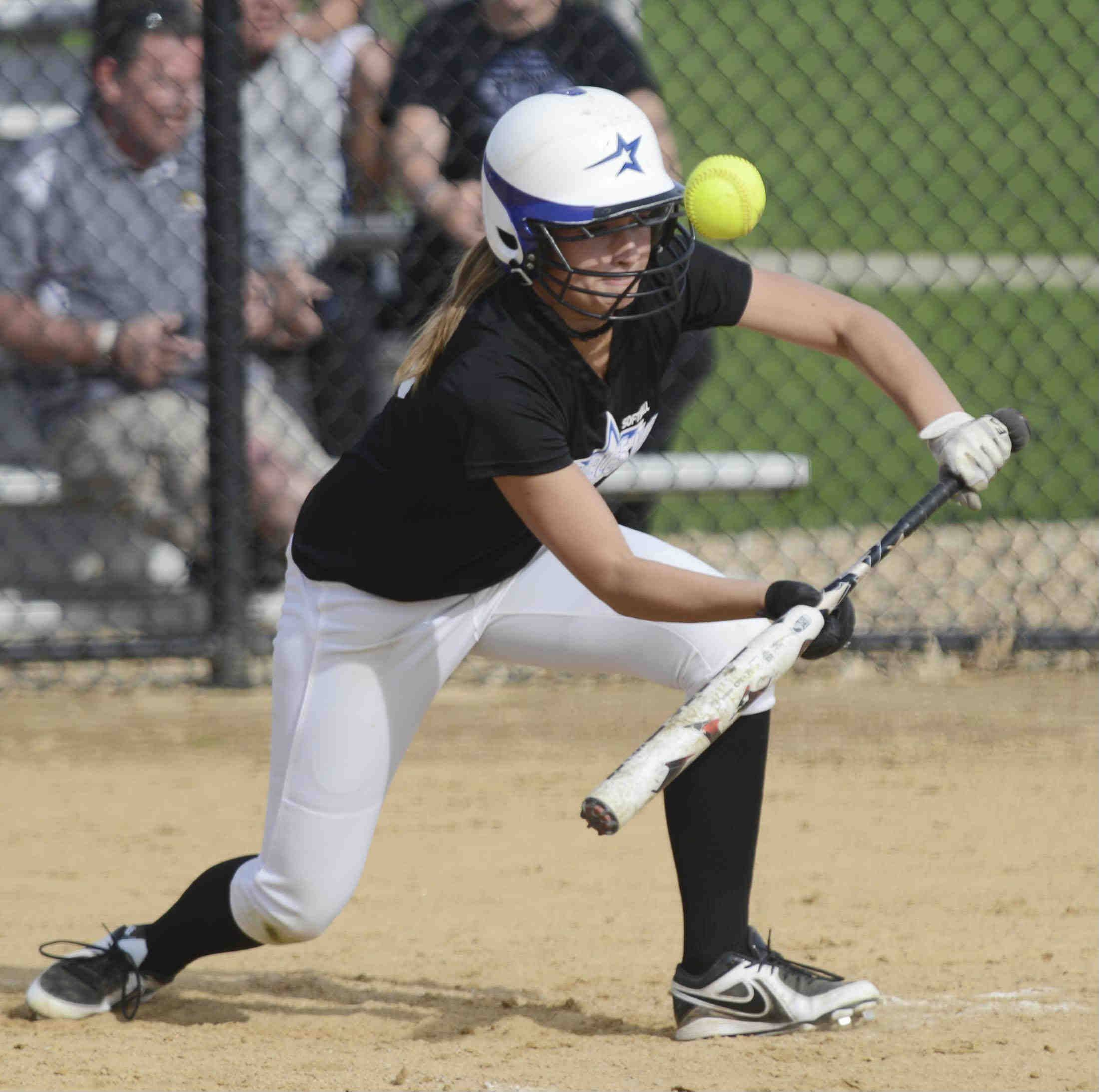 St. Charles North batter Delaney Olinger bunts foul against St. Charles East Monday.