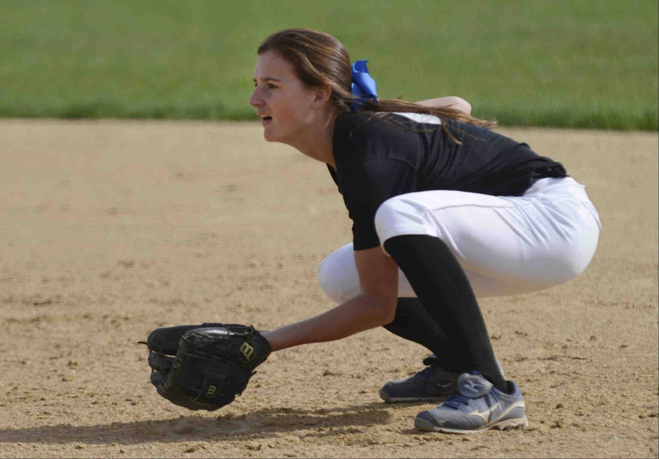 St. Charles North second baseman Kaitlyn Waslawski gets in position as a pitch is delivered against St. Charles East Monday.