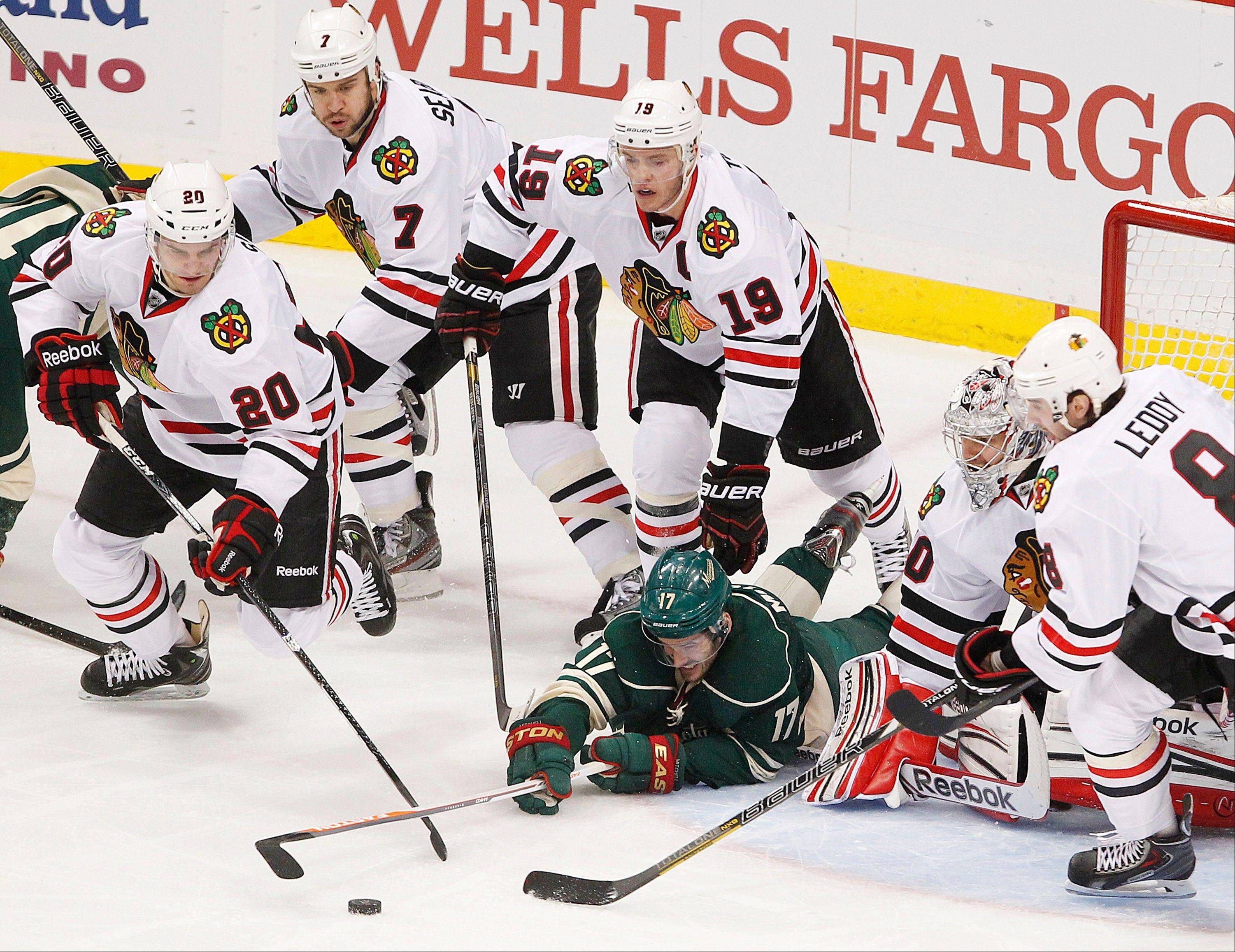 The Hawks need to have all hands on deck, as on this play when they swarmed around Torrey Mitchell on Sunday during the Wild's 3-2 overtime win in Game 3 of their Western Conference playoff series in Minnesota.