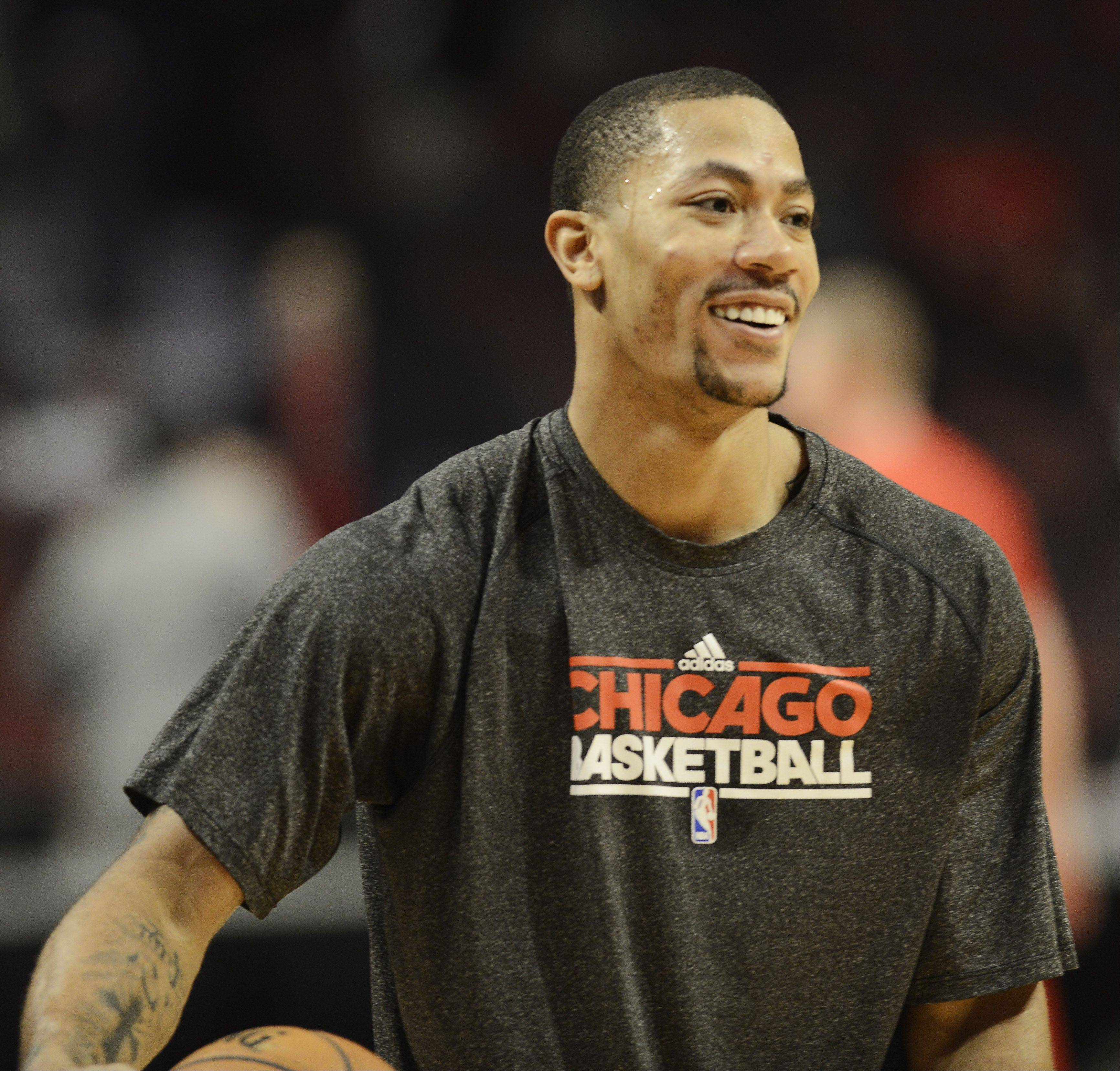 Injured Bulls guard Derrick Rose smiles while shooting before Game 6 against the Brooklyn Nets. Rose said Monday there is still a chance he might return during the playoffs.