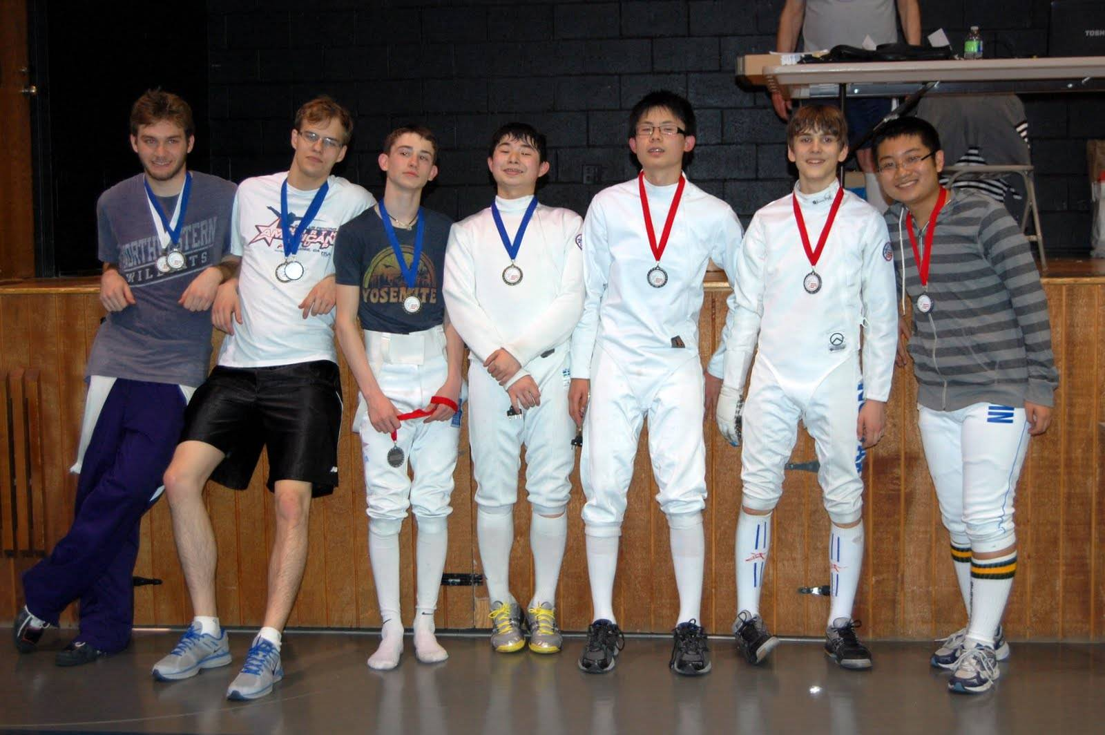 IFC Fencers, and their medals, second from left Maciek Zmyslowski, then Gabe Weininger, Sasha Heber, Zimo Zhu, Jakub Nowak and Andrew Jin.