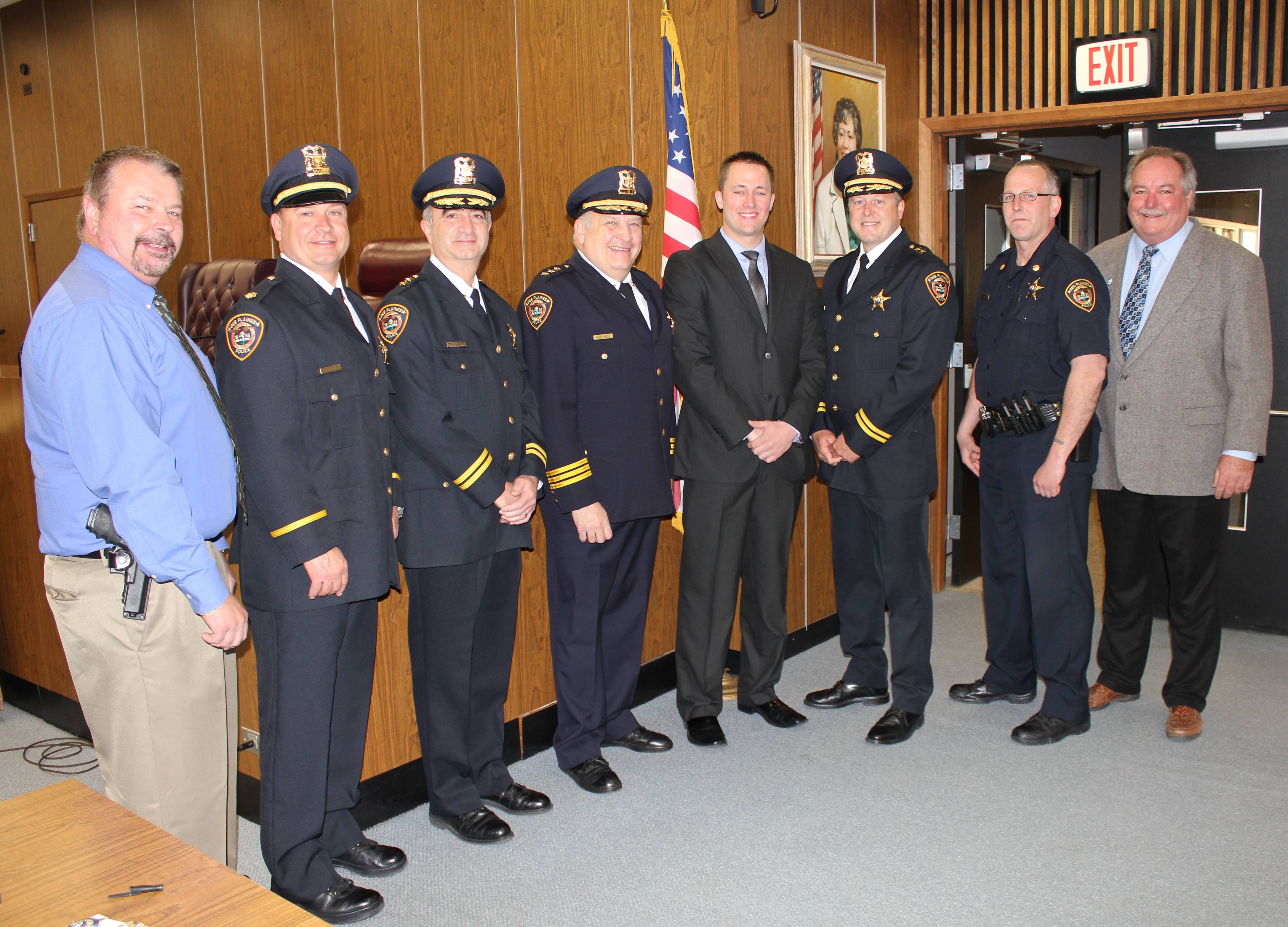 (pictured left to right) Des Plaines Police Commander Randy Akin, Commander Chet Zaprzalka, Deputy Chief Nick Treantafeles, Chief William Kushner, newly sworn Police Patrol Officer Dustin Kauth, Deputy Chief Paul Burger, Commander Chris Mierzwa, and Acting Mayor Mark Walsten pose for a photograph in the City Council Chambers following the swearing in ceremony on Thursday, May 2, 2013.