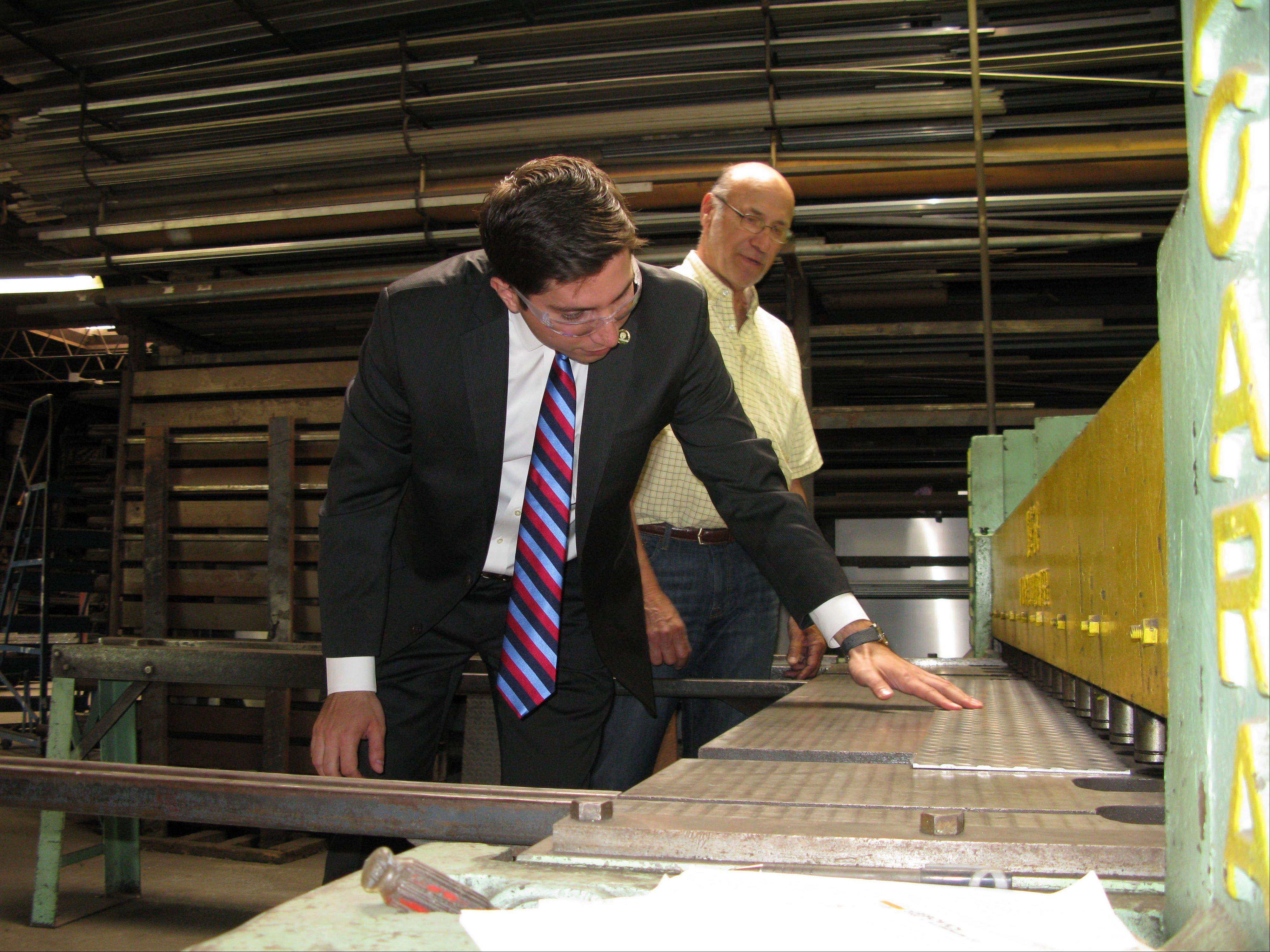 Des Plaines Mayor Matt Bogusz kicks off his first day on the job by touring businesses before heading to Springfield to meet with the city's lobbyists and lawmakers to talk about proposed gambling expansion legislation. Here Bogusz learns how to shear metal.