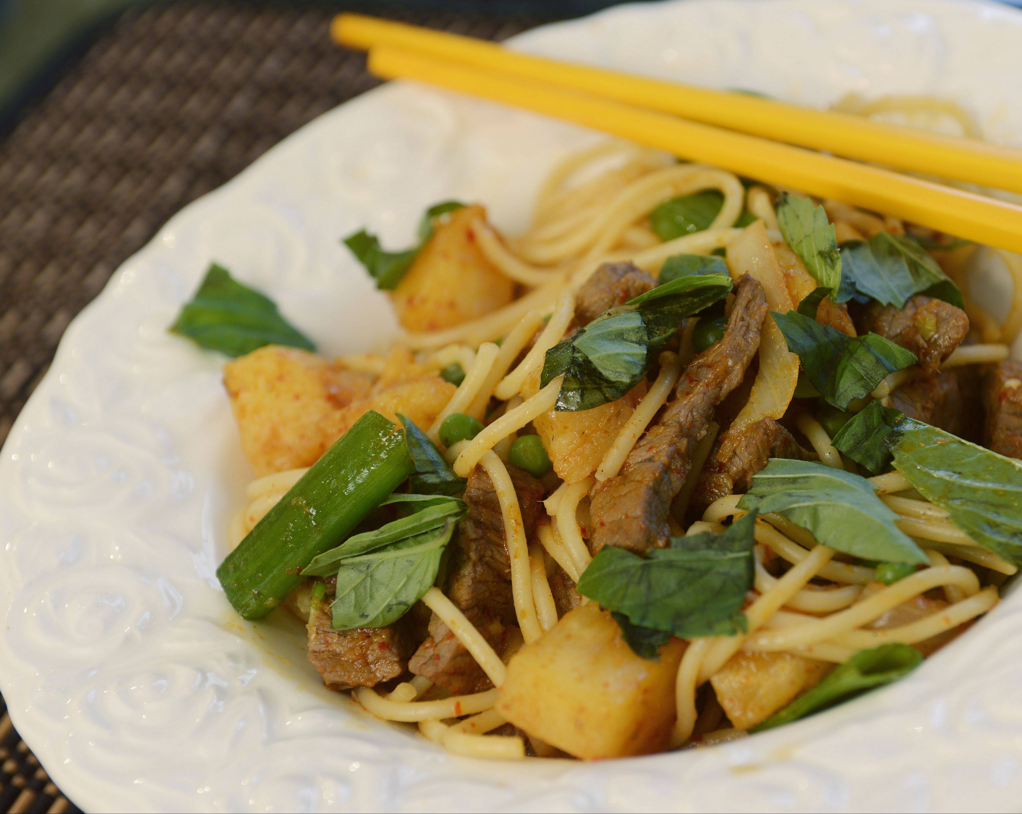 JOE LEWNARD/jlewnard@dailyherald.com �Beef on Fire� is a Thai-inspired stir-fry dish Dan and Ed Kurnick make in their Hoffman Estates kitchen.