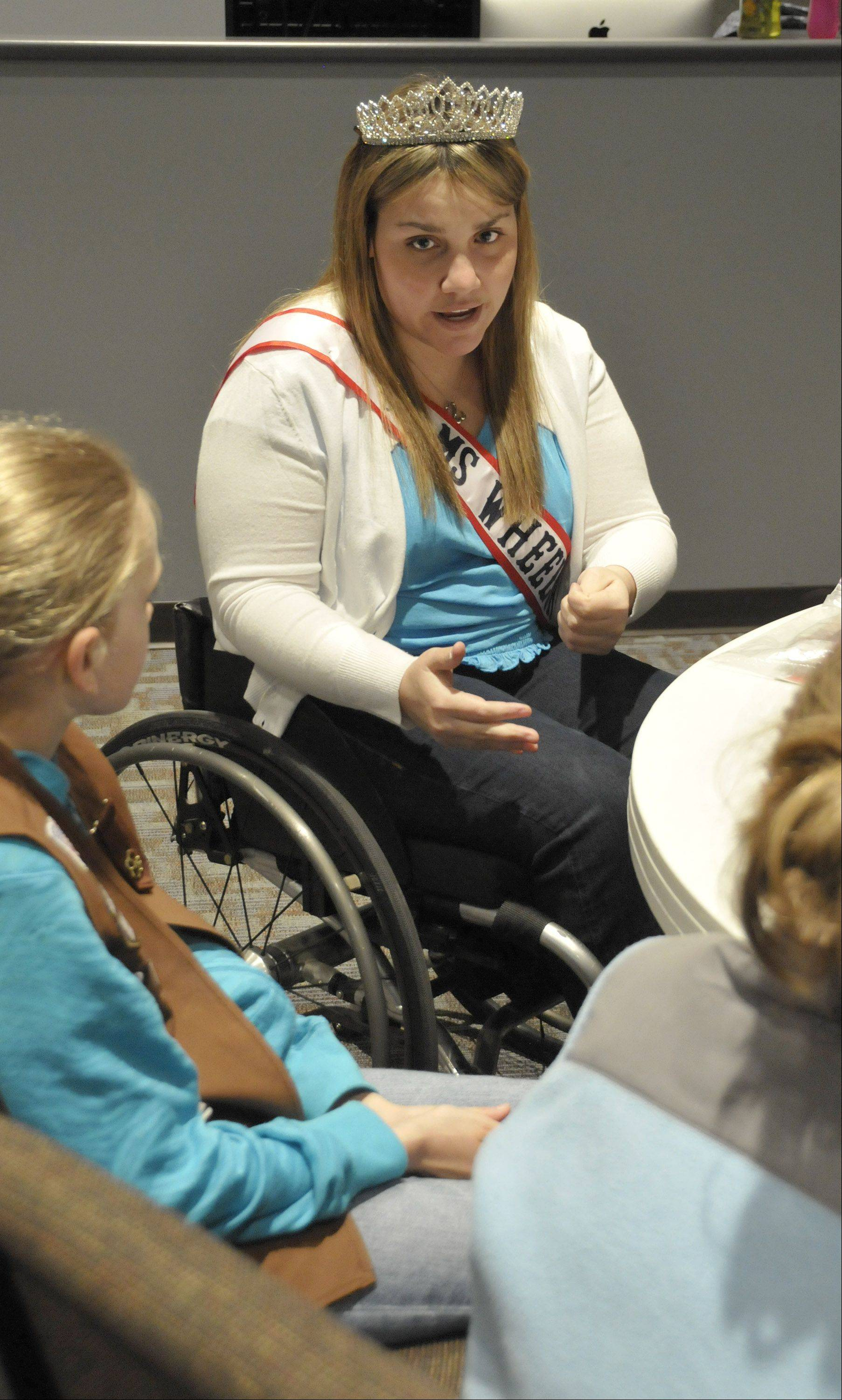 Danielle Austin of Carol Stream speaks Friday to Brownie Troop 50877 in Lisle about how she has dealt with her cerebral palsy. Her platform is disability awareness.