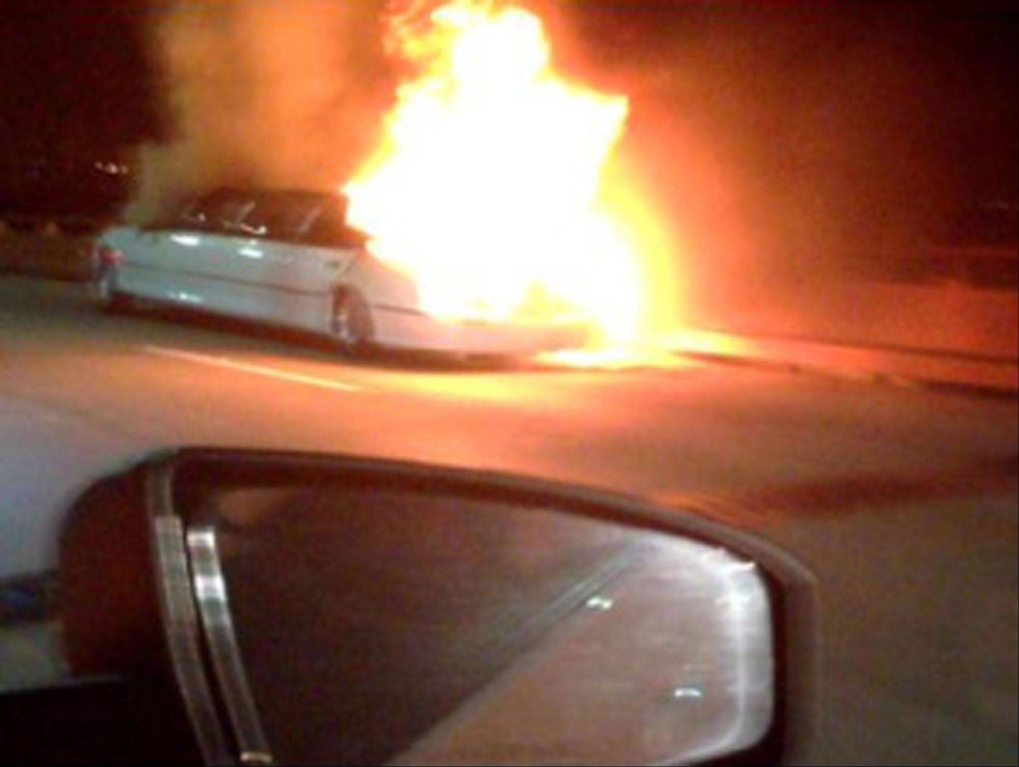 This frame grab taken from video shows a limo on fire Saturday, May 4, 2013, on the San Mateo-Hayward Bridge in San Francisco. Five dead female bodies were found pressed up against the partition behind the driver, where they apparently tried to escape the smoke and fire that kept them from the rear exits of the extended passenger compartment.