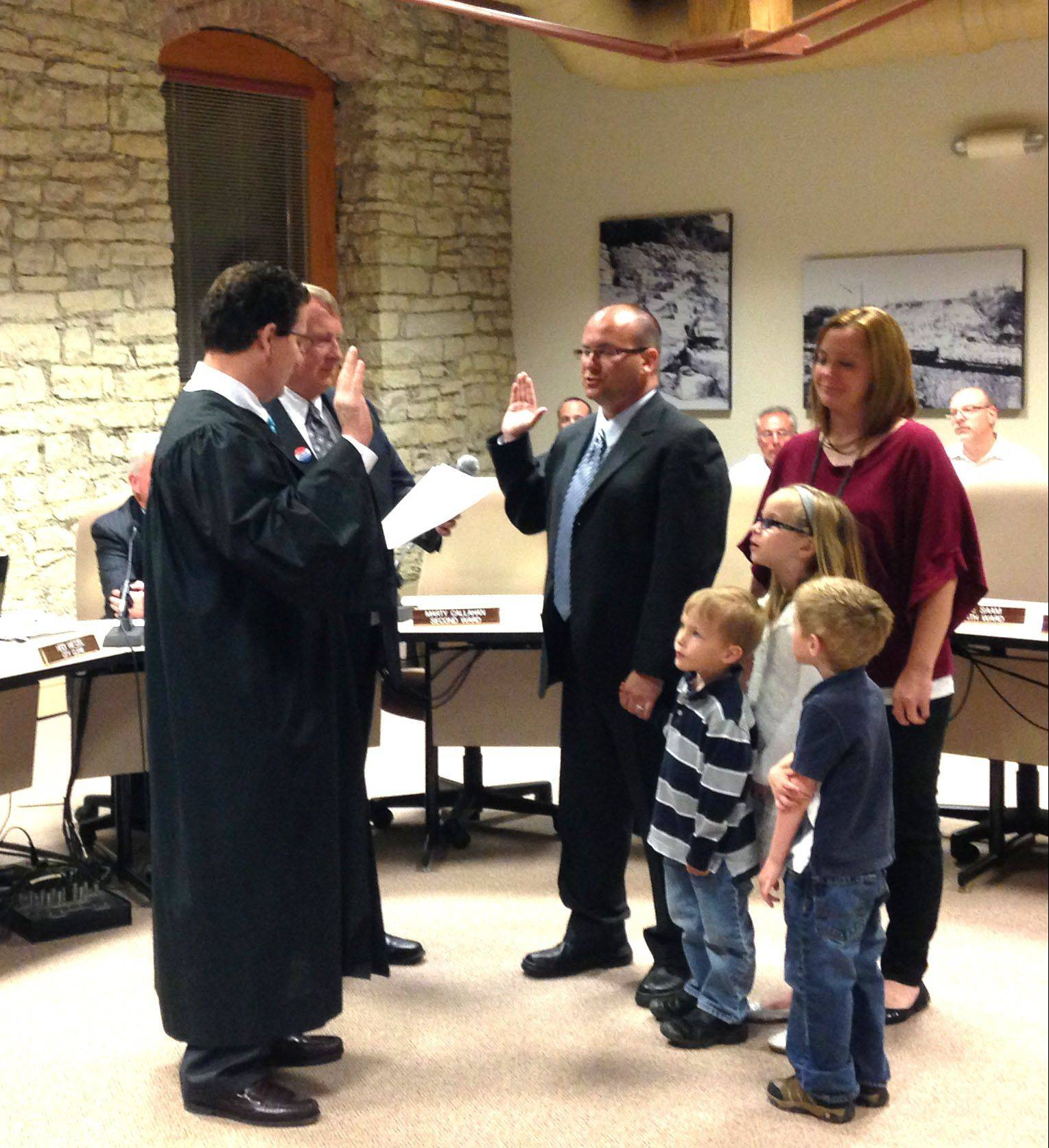 Kane County Circuit Judge Kevin Busch administers the oath of office Monday night to Martin Callahan, Batavia�s new 2nd Ward alderman, while Callahan�s family watches.