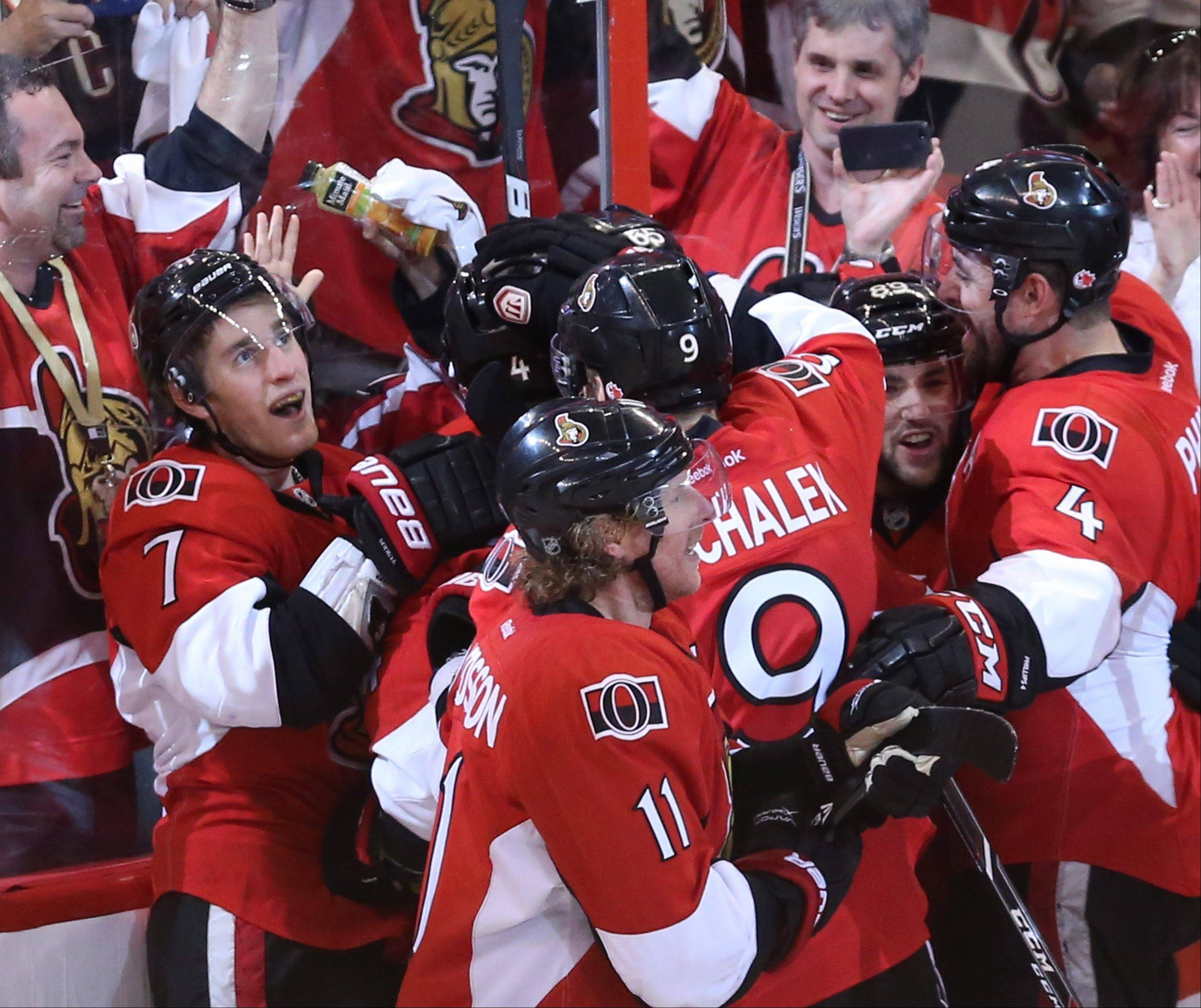 Ottawa Senators' Kyle Turris (7) and teammates celebrate a 3-2 overtime win against the Montreal Canadiens in Game 4 of an NHL hockey Stanley Cup playoff series in Ottawa, Ontario, on Tuesday, May 7, 2013. (AP Photo/The Canadian Press, Fred Chartrand)