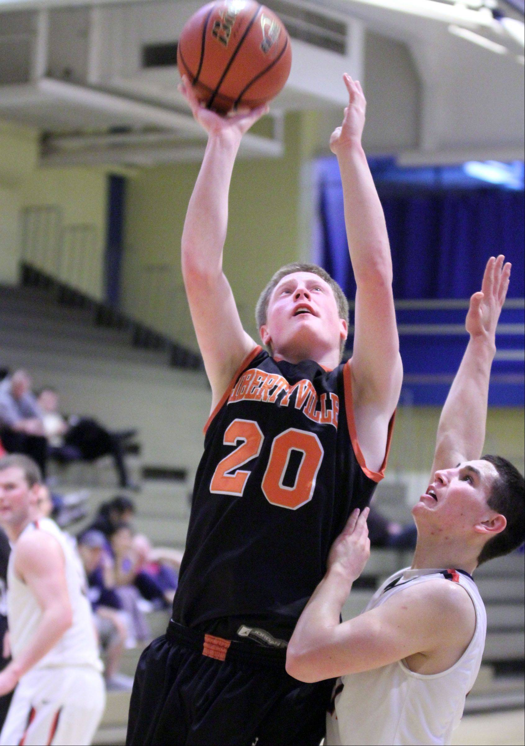 Libertyville�s Jack Lipp shoots over St. Viator defender Mark Falotico winter at Wheeling.