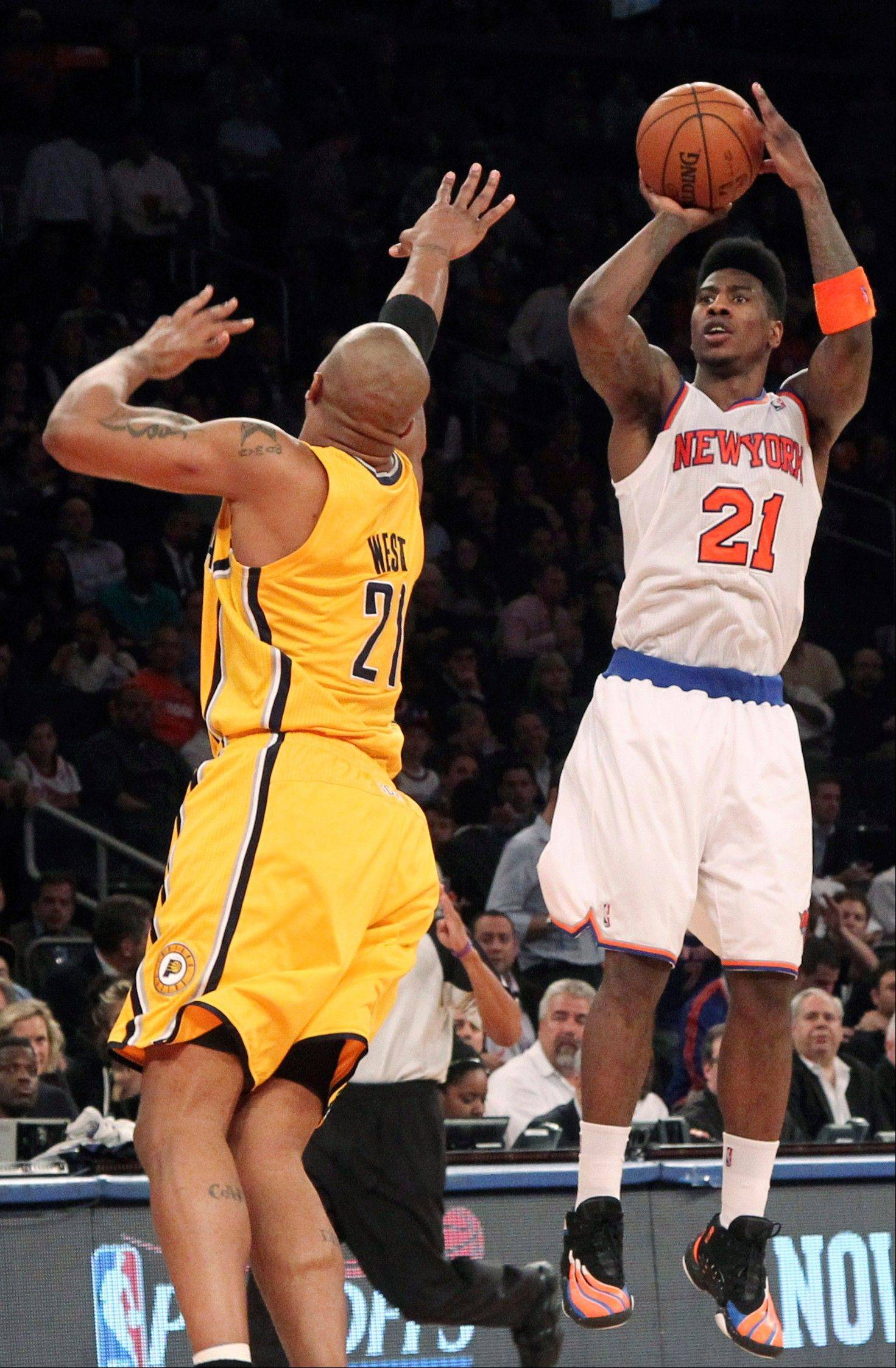 New York Knicks' Iman Shumpert (21) shoots a 3-pointer against Indiana Pacers' David West in the second half of Game 2 of their NBA basketball playoff series in the Eastern Conference semifinals at Madison Square Garden in New York, Tuesday, May 7, 2013. The Knicks won 105-79. (AP Photo/Mary Altaffer)