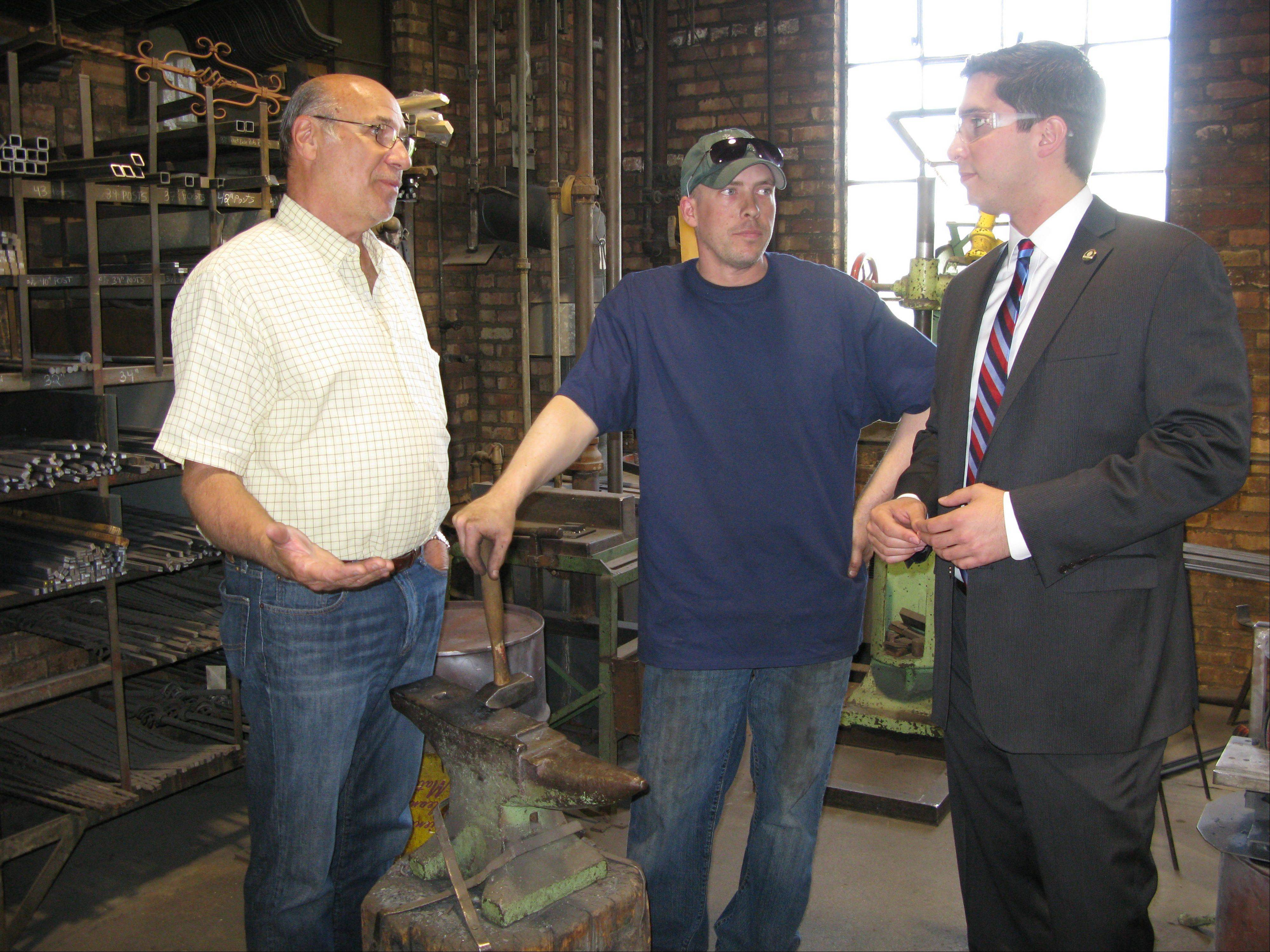 From left, Steve Burval, owner of J.B. Metal Works in Des Plaines, and his longtime employee, Mike Jaeger, give new Mayor Matt Bogusz, right, a tour of the business on Lee Street. Bogusz kicked off his first day on the job by visiting three local businesses before heading to Springfield to meet with the city's lobbyists and lawmakers.