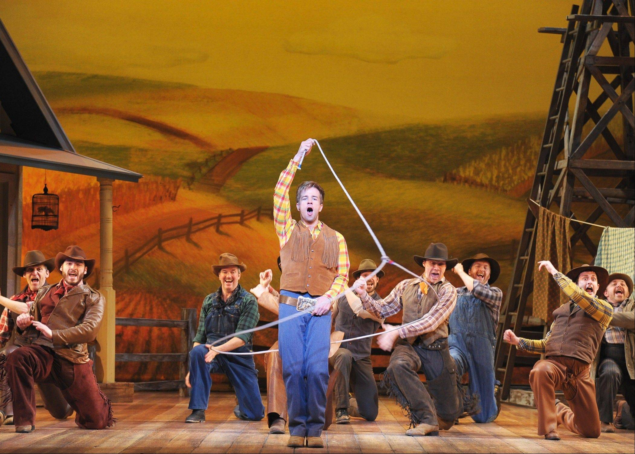 "Will Parker (Curtis Holbrook, center) shows off some of his winning lasso skills in the production number ""Kansas City"" in the Lyric Opera of Chicago's new production of Rodgers and Hammerstein's landmark 1943 musical ""Oklahoma!"" The production runs through Sunday, May 19."