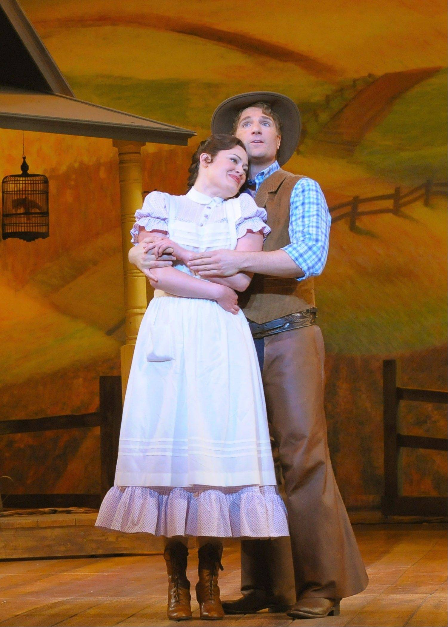 "Laurie (Ashley Brown) and Curly (John Cudia) wonder if ""People Will Say We're In Love"" in the Lyric Opera of Chicago's new production of Rodgers and Hammerstein's 1943 Broadway musical ""Oklahoma!"" now playing though Sunday, May 19."