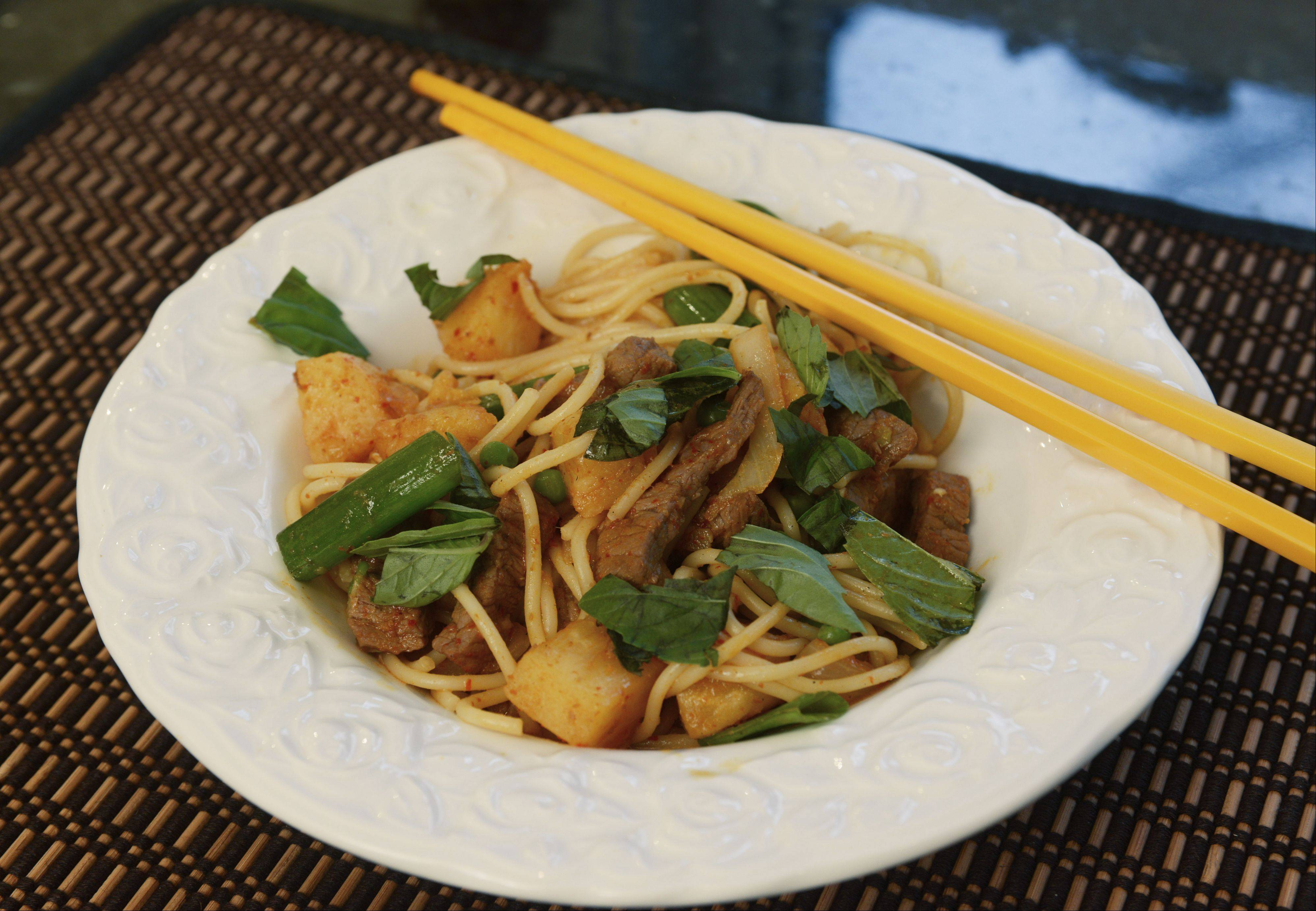"""Beef on Fire"" is a Thai-inspired stir-fry that Dan and Ed Kurnick prepare in their of Hoffman Estates kitchen."