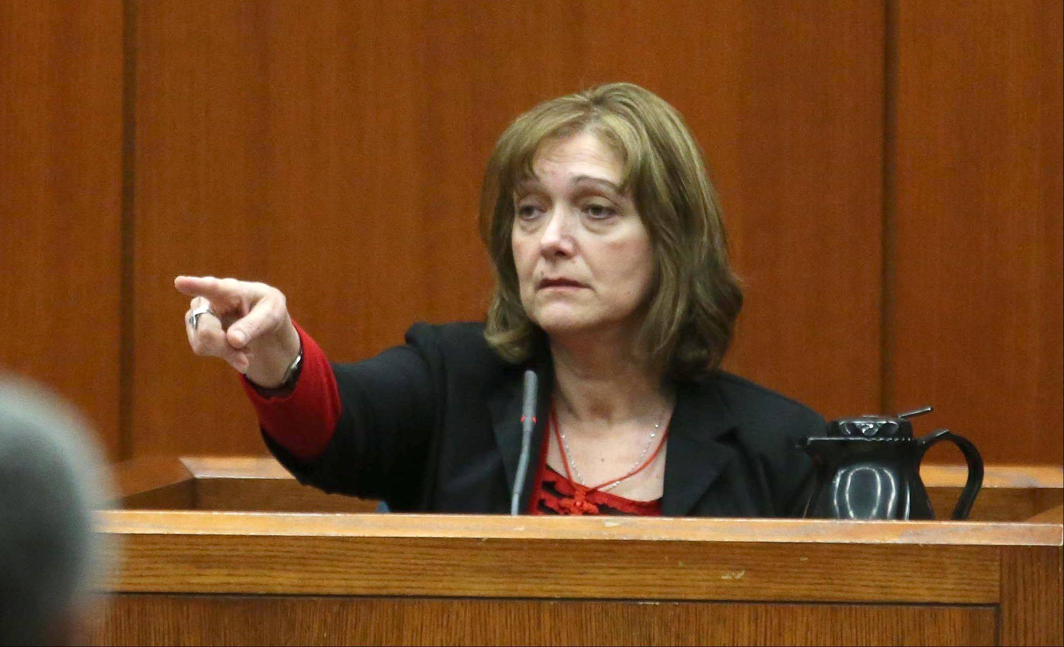 Christina Borizov identifies her son Johnny Borizov during his triple-murder trial Tuesday in Wheaton.