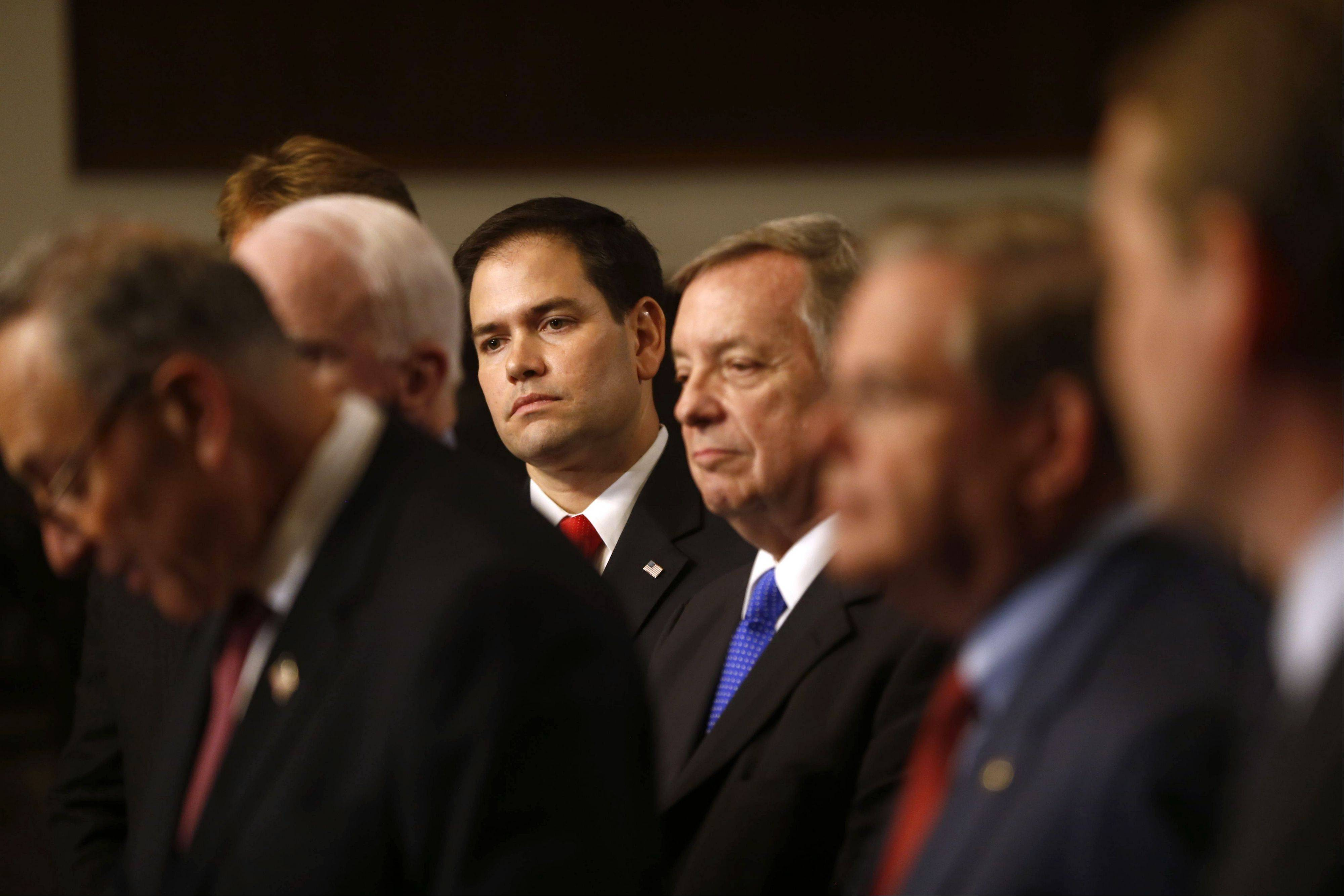 Sen. Marco Rubio, a Florida Republican, center, and others Senators, including Senate Majority Whip Richard Durbin, an Illinois Democrat, to the right of Rubio, discussimmigration legislation last month on Capitol Hill.