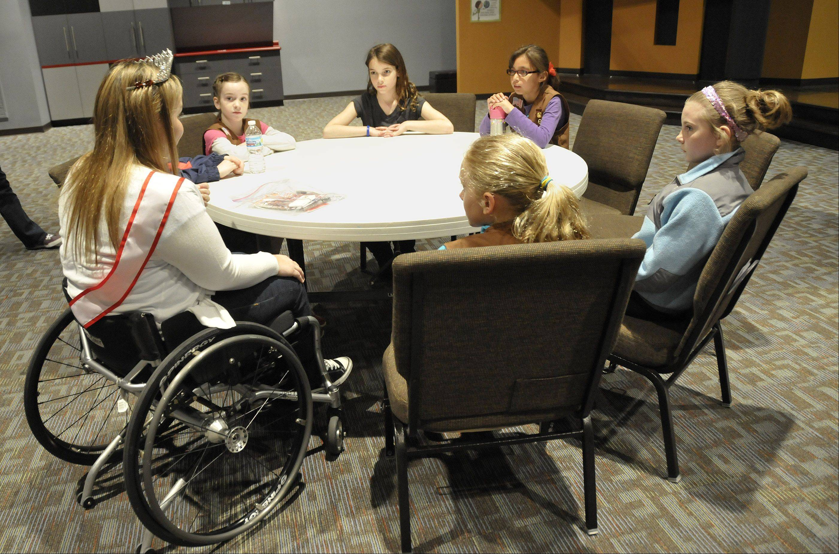 Ms. Wheelchair Illinois Danielle Austin talks with Brownie Troop 50877 in Lisle about what it's like to have a disability.