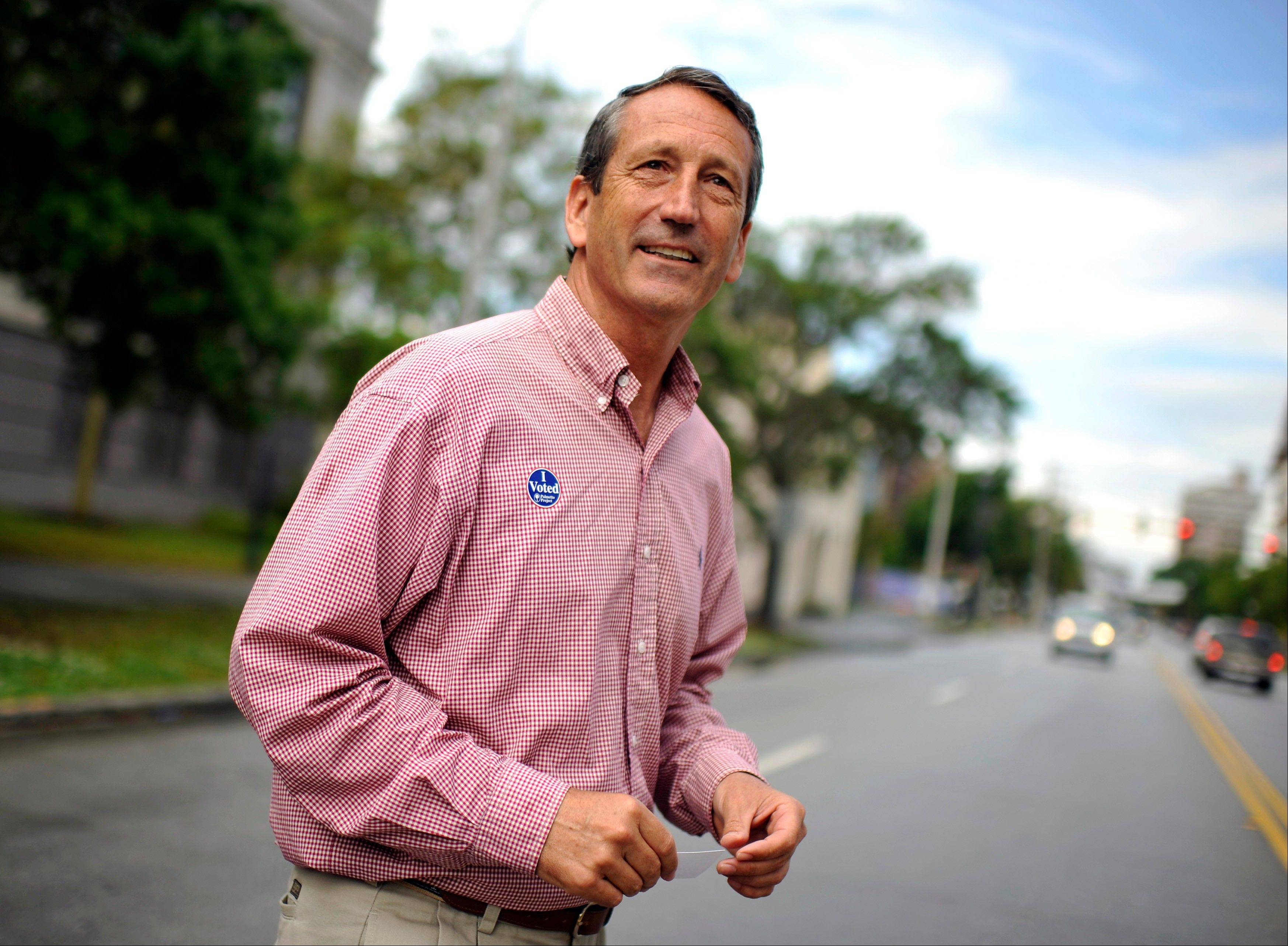 Former South Carolina Gov. Mark Sanford crosses the street after voting at a polling place in Charleston, S.C., Tuesday, May 7, 2013. Sanford, a Republican, and Colbert Busch, a Democrat and sister of political satirist Stephen Colbert, are to face off for the 1st Congressional District seat, that was vacated when Tim Scott was appointed to the U.S. Senate. Green Party candidate Eugene Platt also is on the ballot.