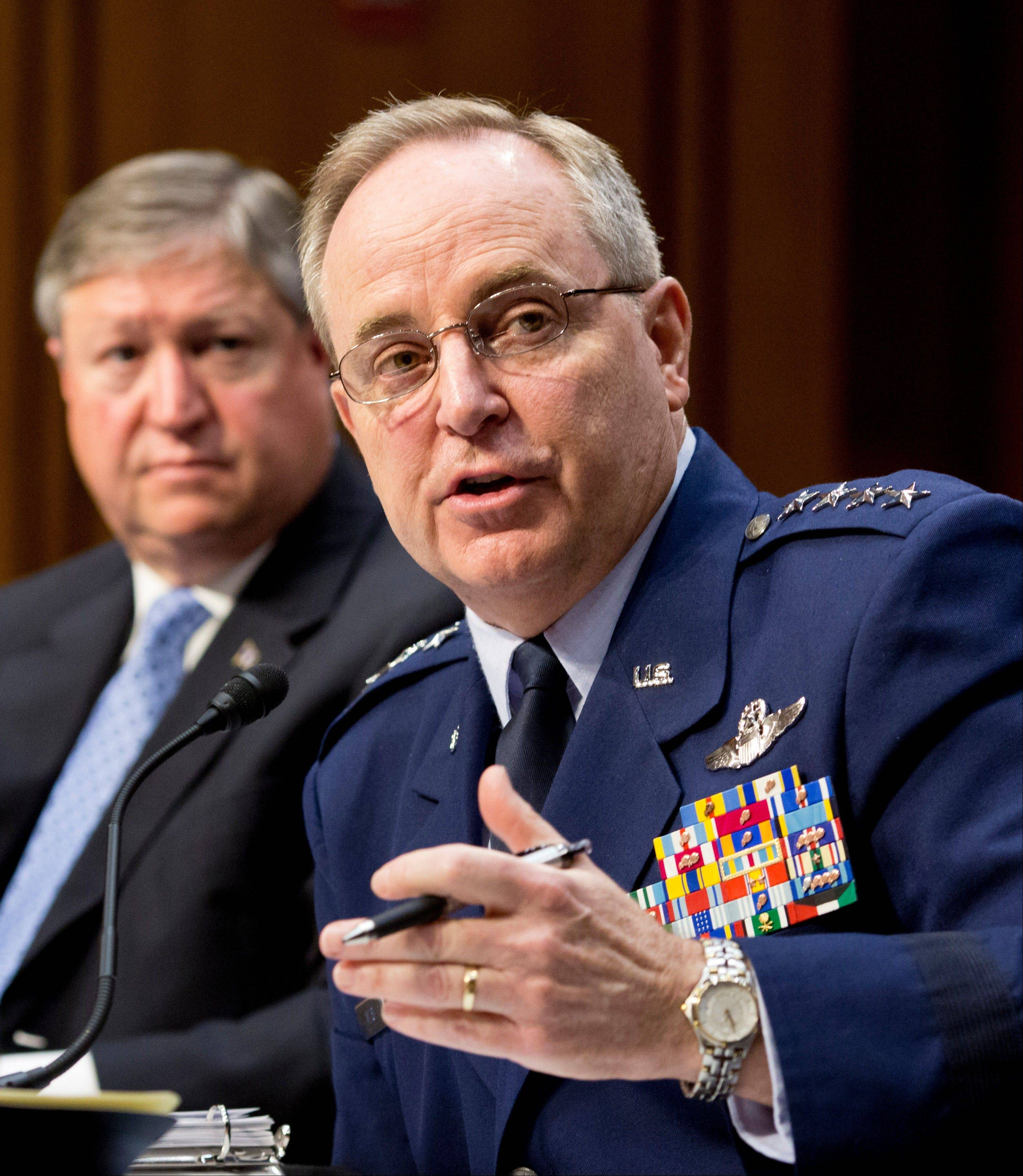 The Senate Armed Services Committee hears from top officials of the Air Force, Air Force Chief of Staff Gen. Mark A. Welsh III, right, and Secretary of the Air Force Michael B. Donley, left, during a hearing on Capitol Hill in Washington Tuesday.
