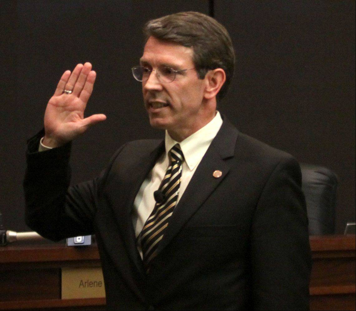 Thomas Hayes is sworn in as Arlington Heights village president Monday evening.