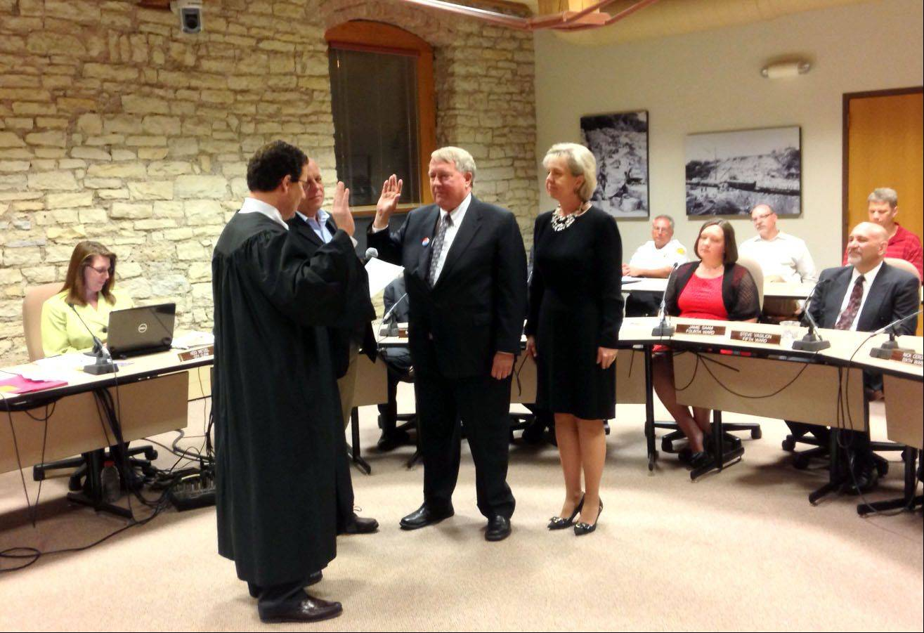 Kane County Circuit Judge Kevin Busch administers the oath of office to Batavia Mayor Jeff Schielke on Monday night.