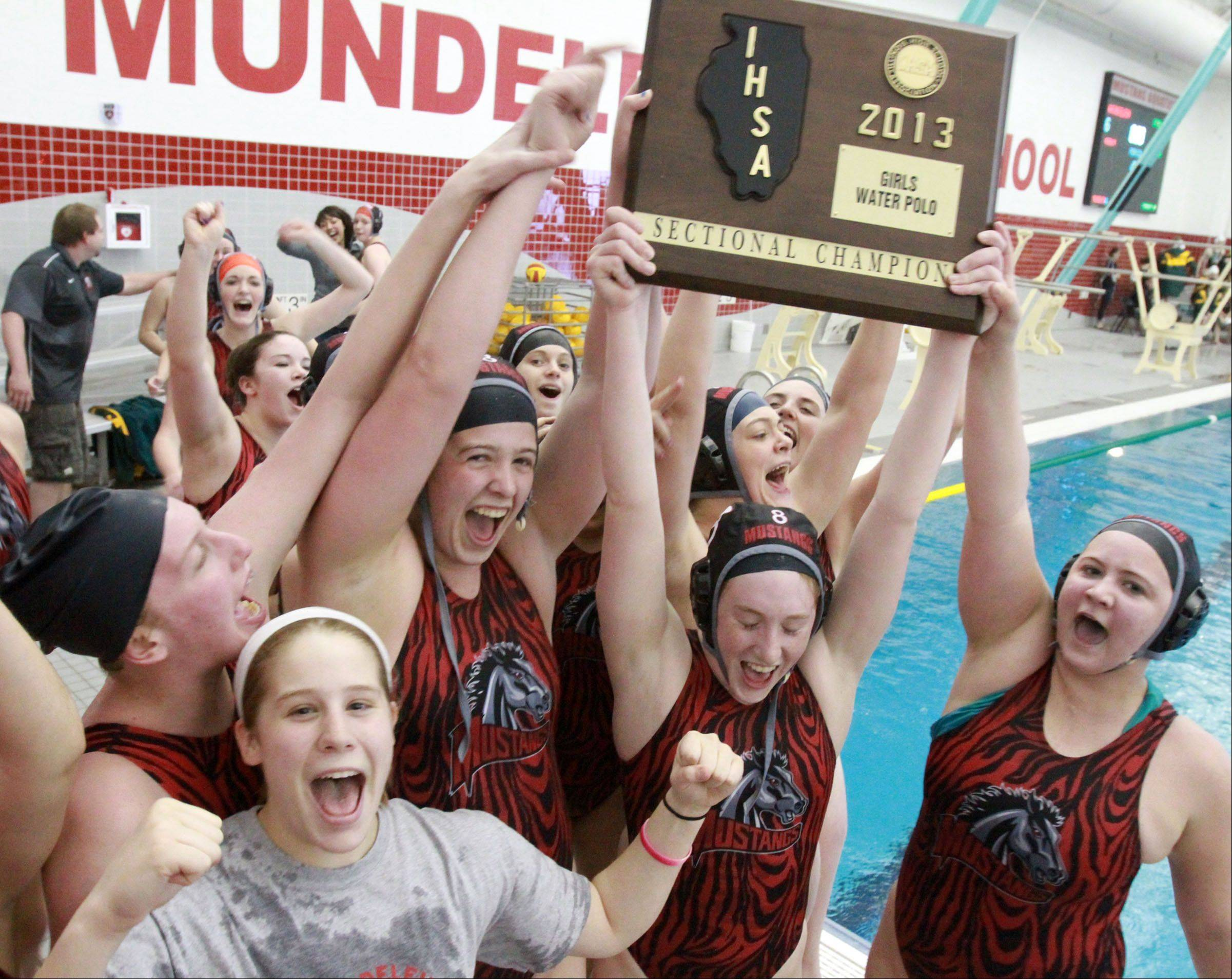 Mundelein celebrates a 6-5 victory over Stevenson in Mundelein sectional championship play Saturday.