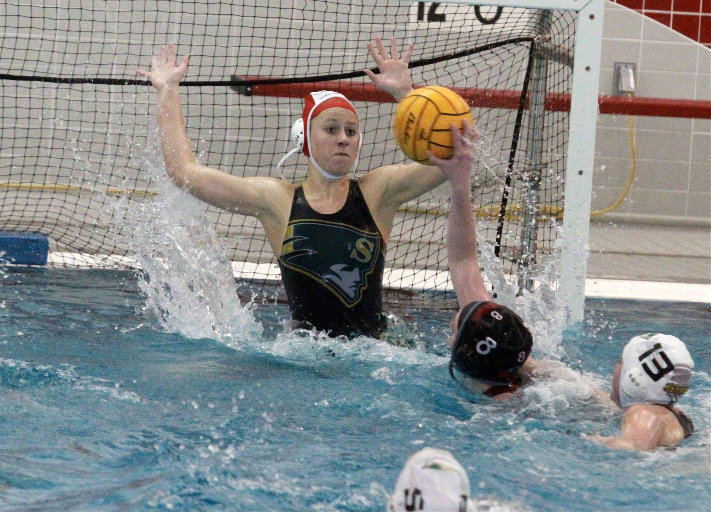 Mundelein's Allie Boothe scores against Stevenson goalie Becky Callen in the Mustangs' 6-5 victory in the Mundelein sectional championship Saturday.