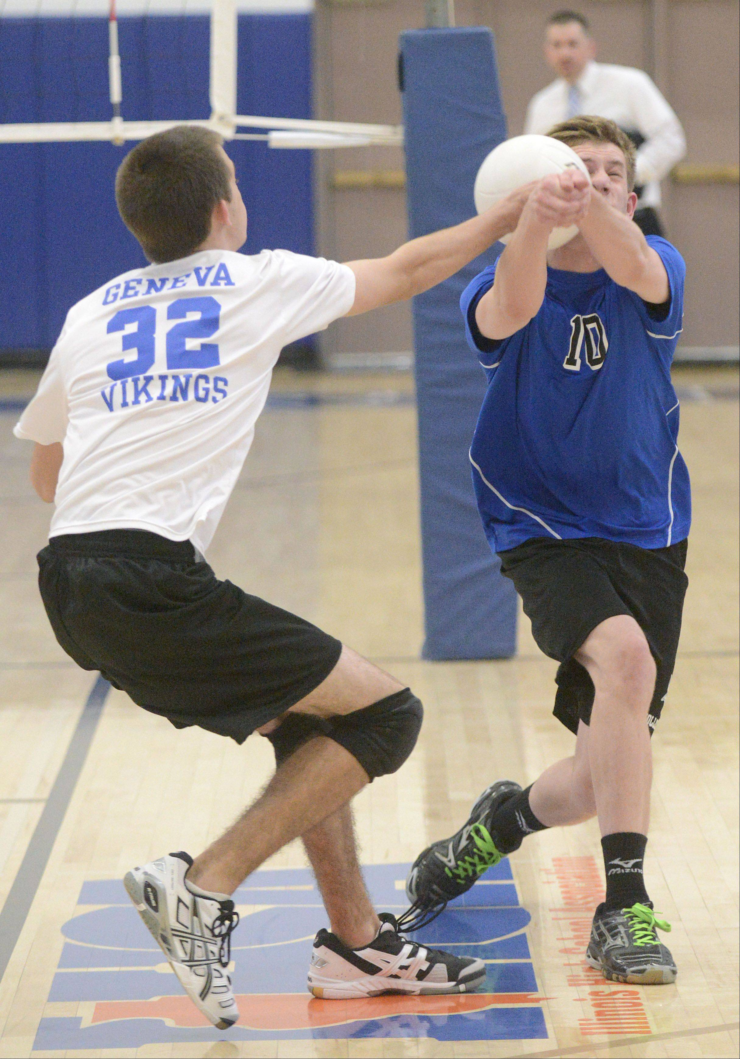Geneva's Brandon Navigato and Nathan Jesko collide in the first match on Tuesday, May 7.