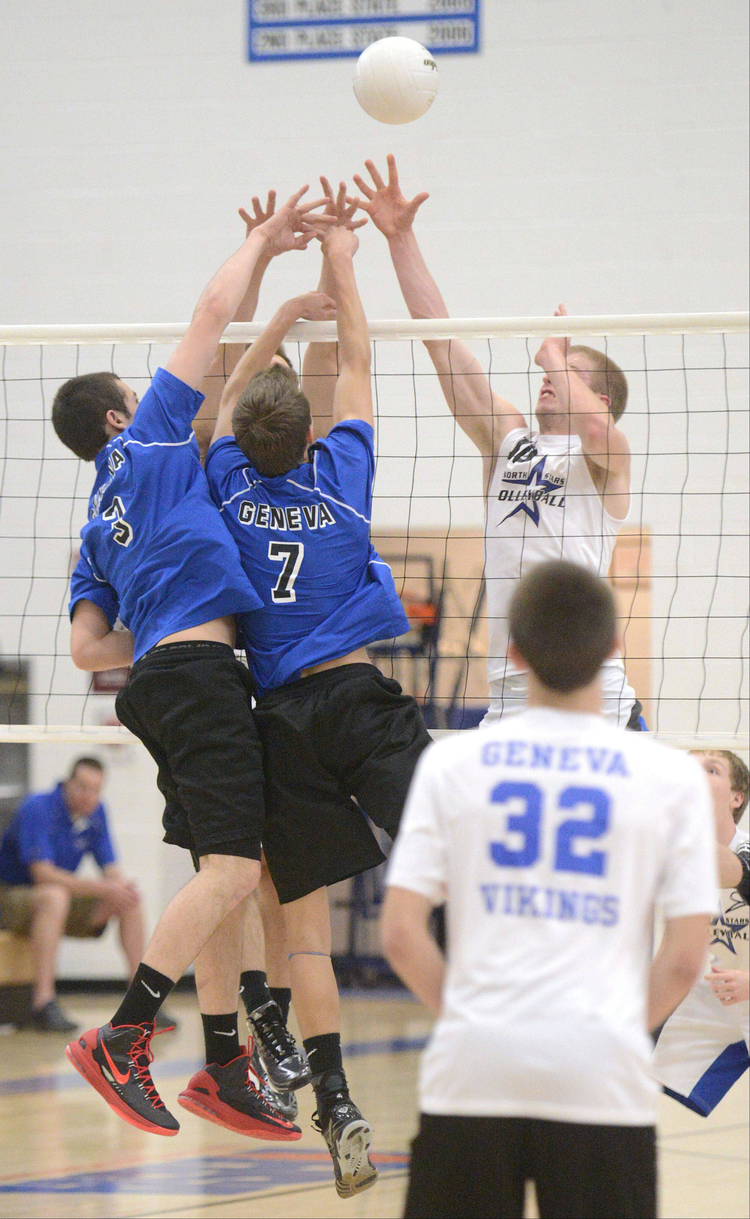 Geneva's Chris Parilli and Dominic Bondi battle St. Charles North's Pat Misiewicz and Kevin Beach at the net in the first match on Tuesday, May 7.
