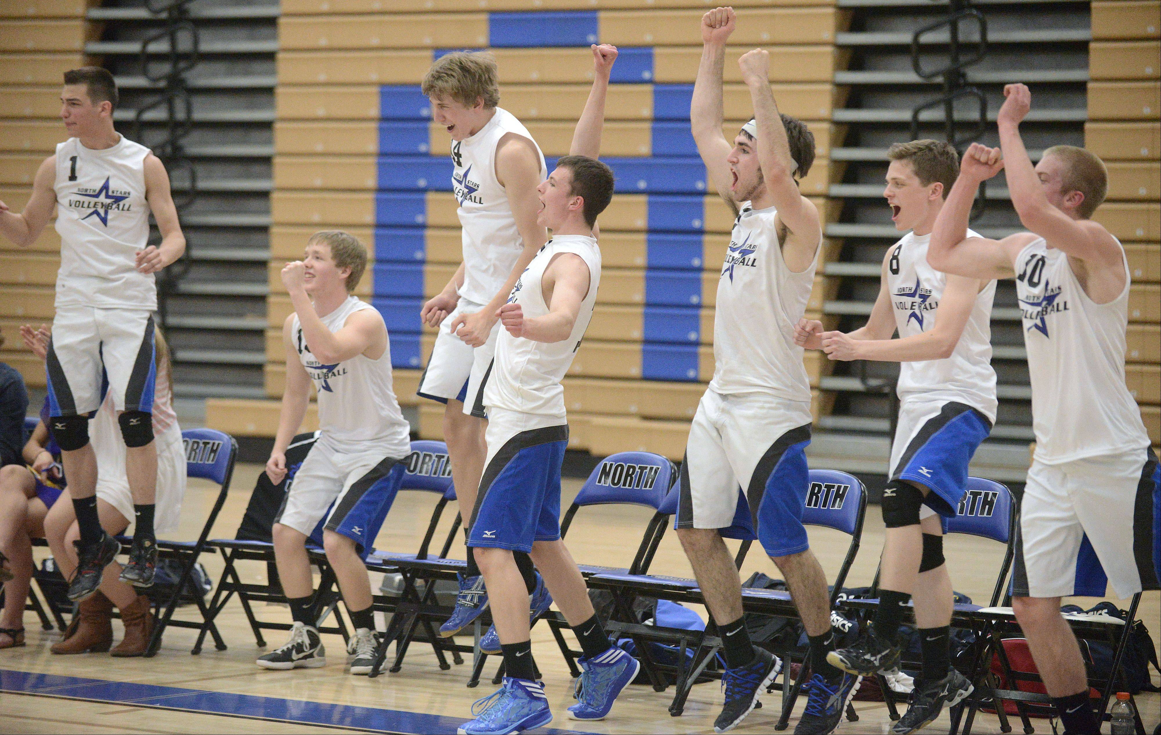 The St. Charles North bench erupts in celebration after scoring the winning point over Geneva in the second match on Tuesday, May 7.