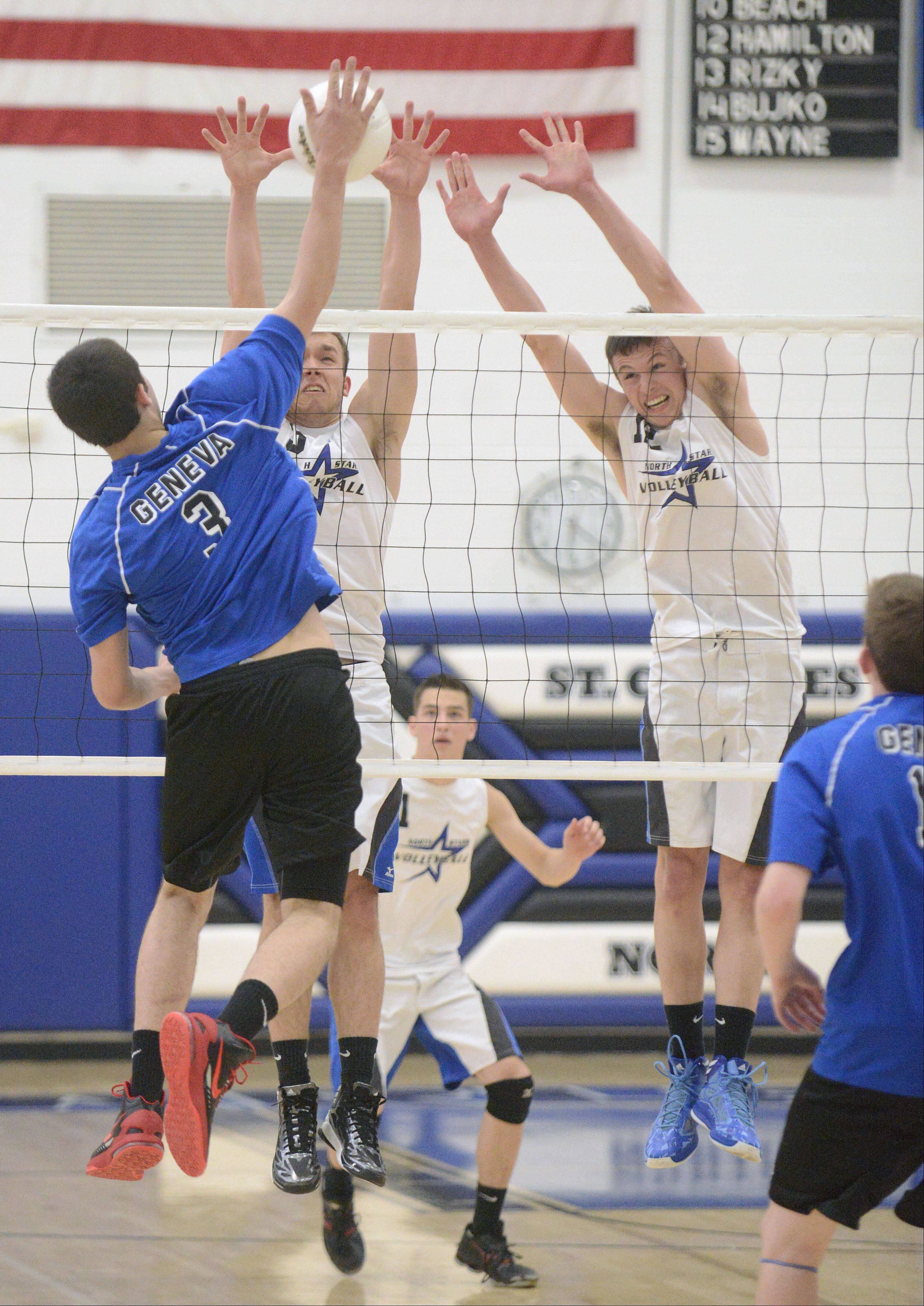 St. Charles North's Pat Misiewicz and Jake Hamilton block a spike by Geneva's Chris Parilli in the second match on Tuesday, May 7.