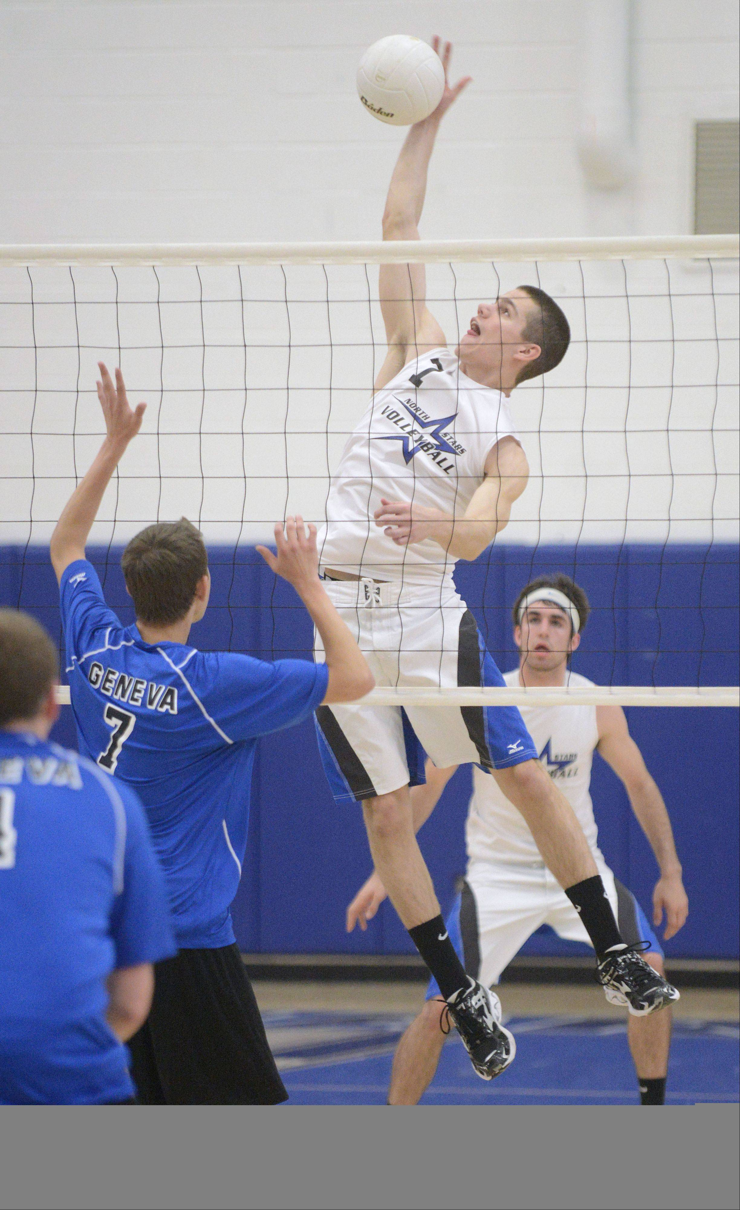St. Charles North's Zach Ziesmer spikes the ball over the net towards Geneva's Dominic Bondi in the first match on Tuesday, May 7.