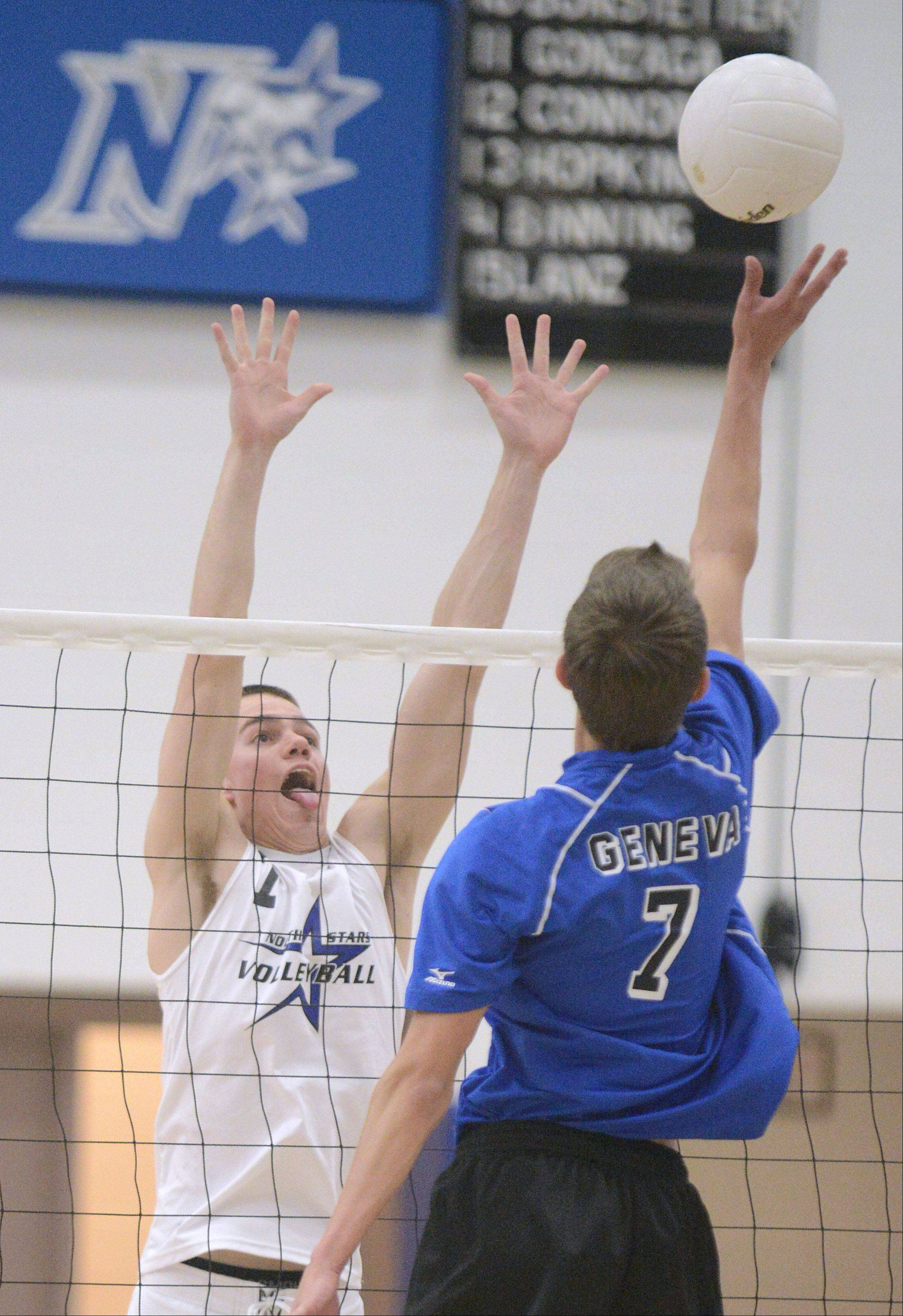 St. Charles North's Zach Ziesmer preps for a tip of the ball over the net from Geneva's Dominic Bondi in the second match on Tuesday, May 7.