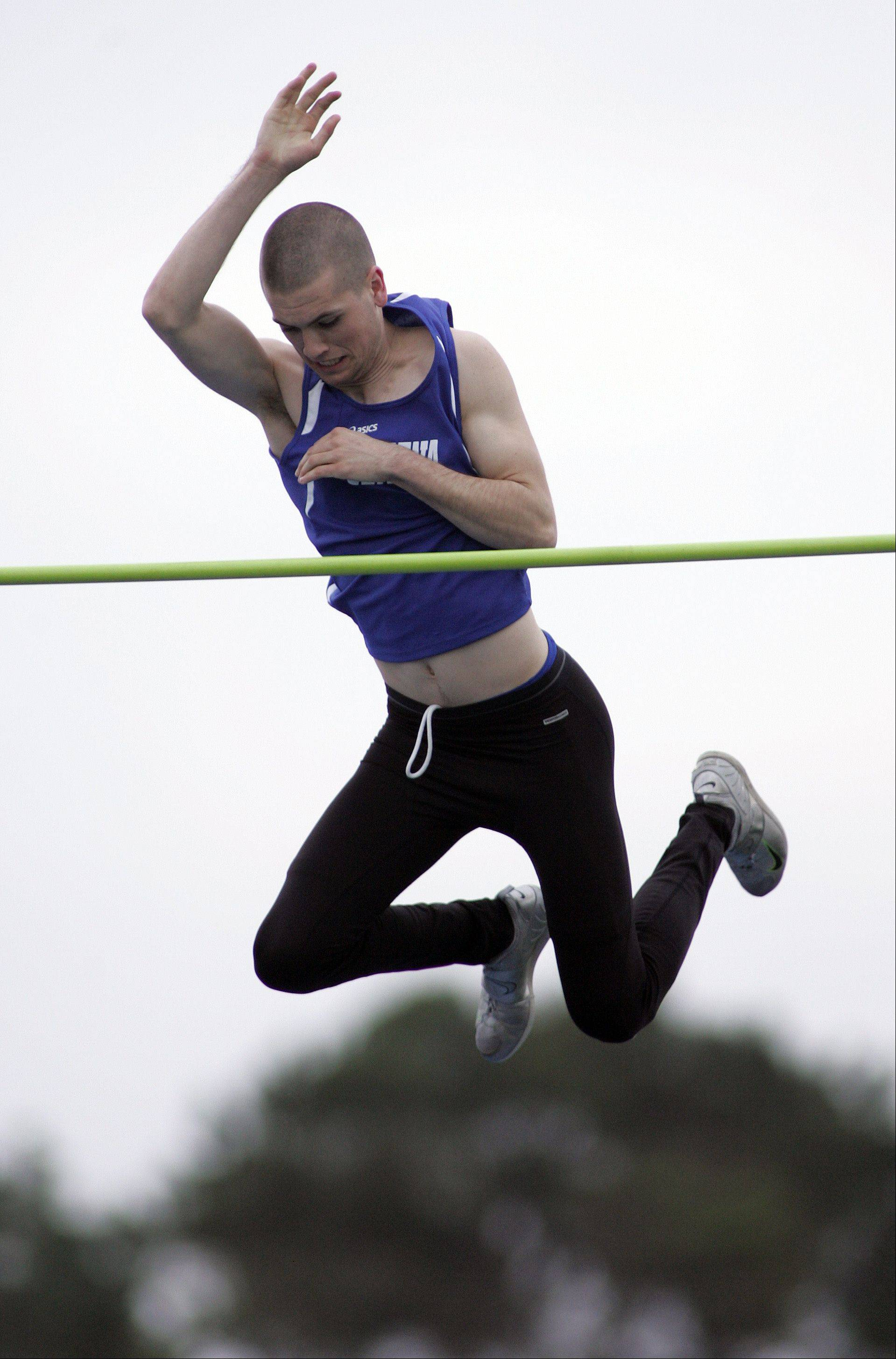 Brian Hill/bhill@dailyherald.comGeneva's Dan Acton competes in the pole vault during the Kane County boys track meet Friday at Burlington Central High School.