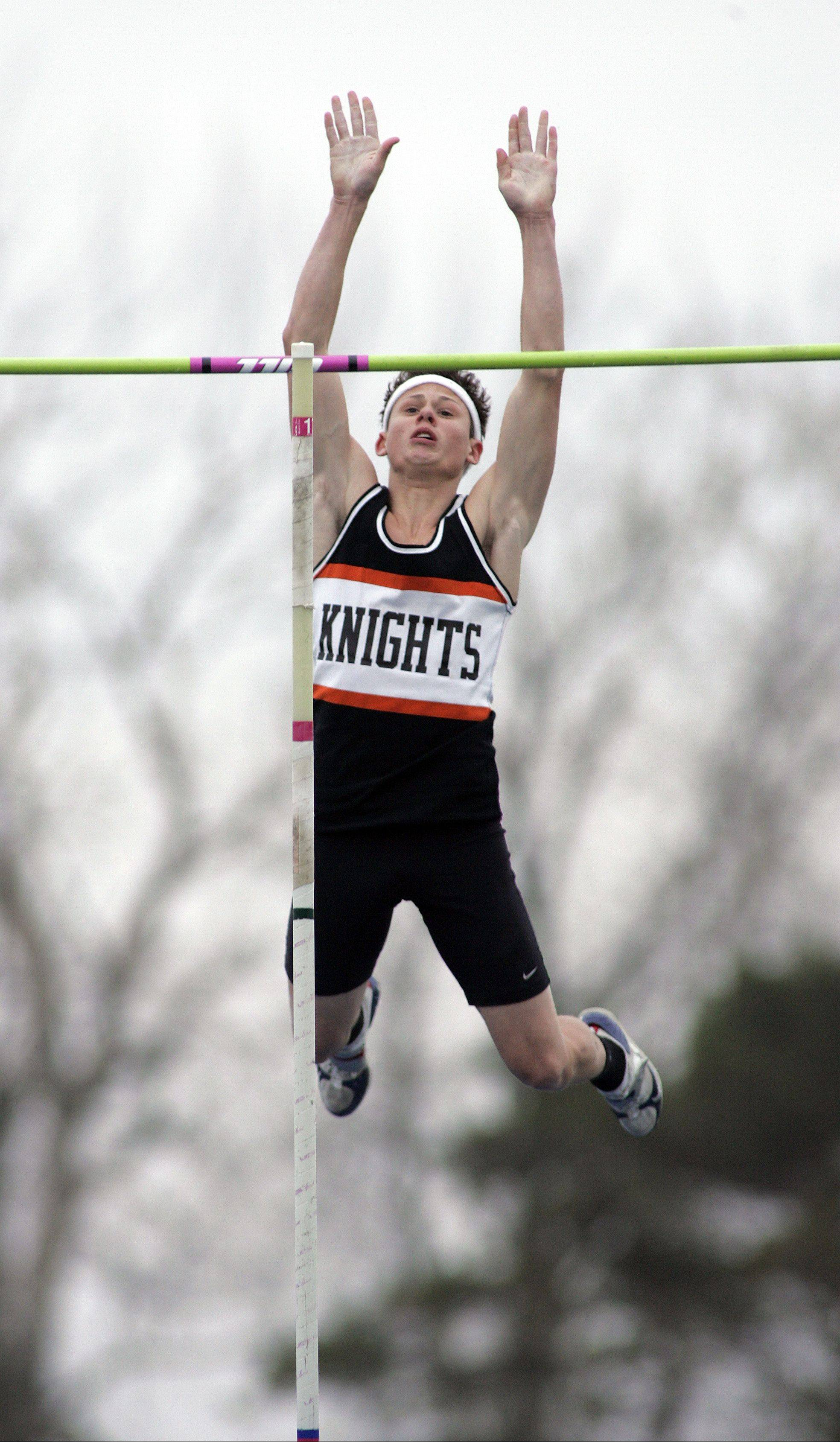 Kaneland's Dylan Kuipers clears the bar in the pole vault during the Kane County meet.
