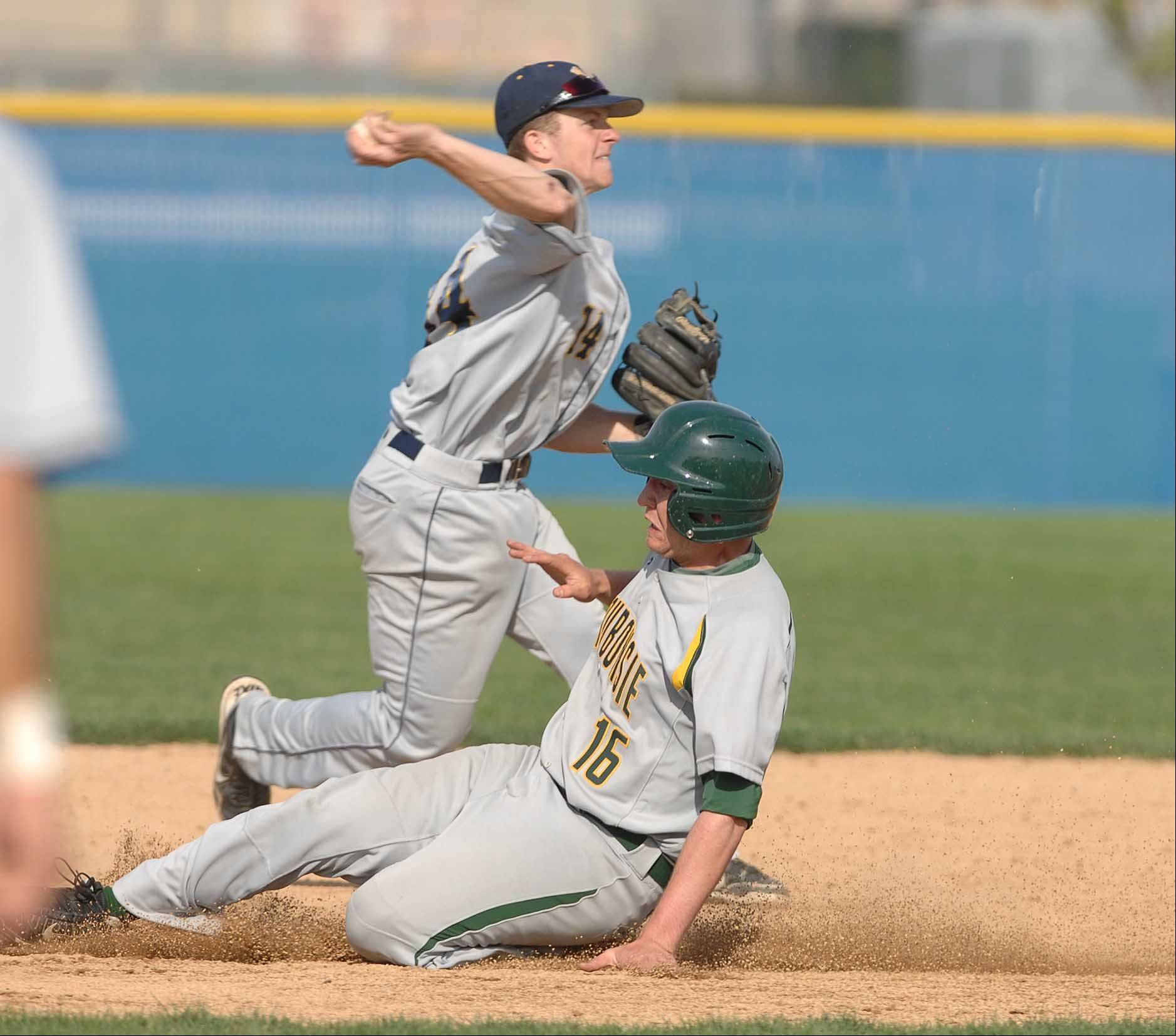Mike Riesner of Neuqua,left, forces out Nick Drago of Waubonsie at second. This took place during the Waubonsie Valley at Neuqua Valley baseball game Tuesday.