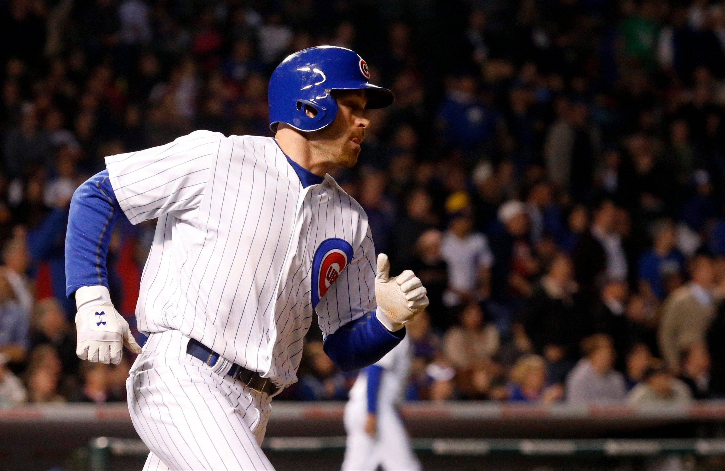 Chicago Cubs' Nate Schierholtz rounds the bases after hitting a two-run home run off St. Louis Cardinals starting pitcher Lance Lynn, also scoring Alfonso Soriano, during the fourth inning of a baseball game, Tuesday, May 7, 2013, in Chicago.
