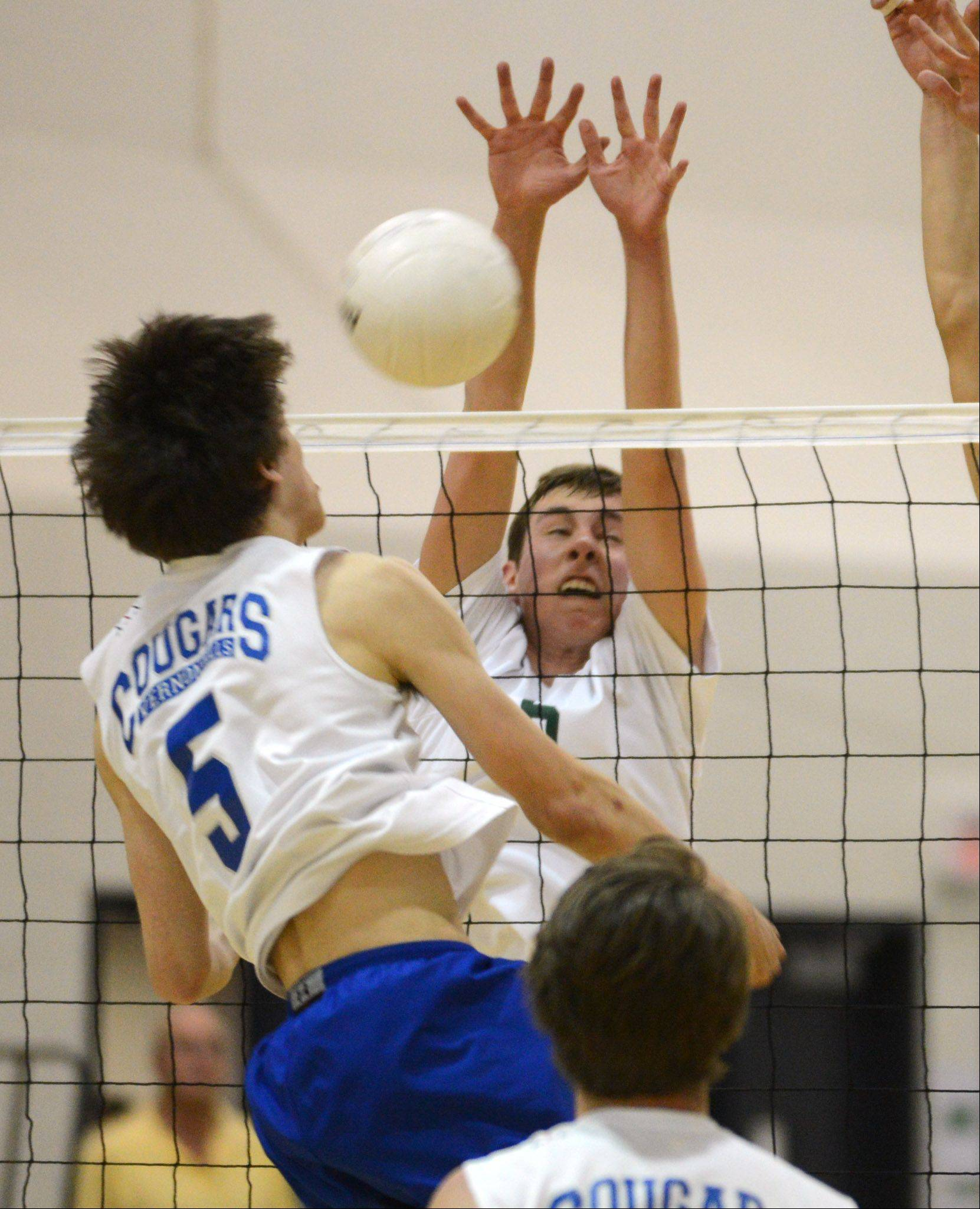 Vernon Hills' Max Spiglanin (5) tries to knock the ball past Stevenson's Jonah May during the volleyball match Tuesday night in Lincolnshire.