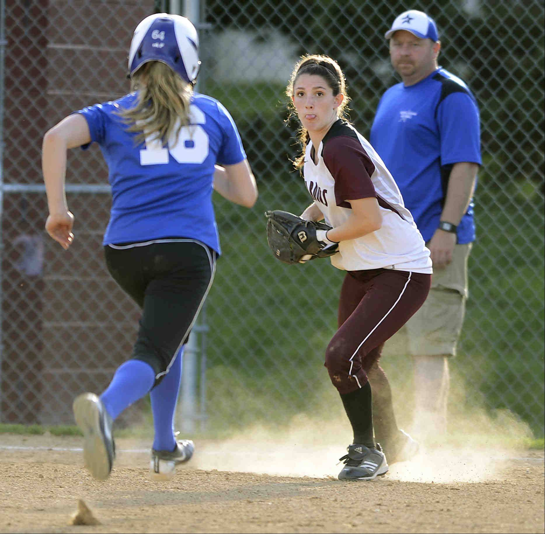 Elgin third baseman Jennah Perryman steps toward St. Charles North baserunner Samantha Hausl to tag her out after fielding a ground ball by Katie Roggemann Tuesday in Elgin.