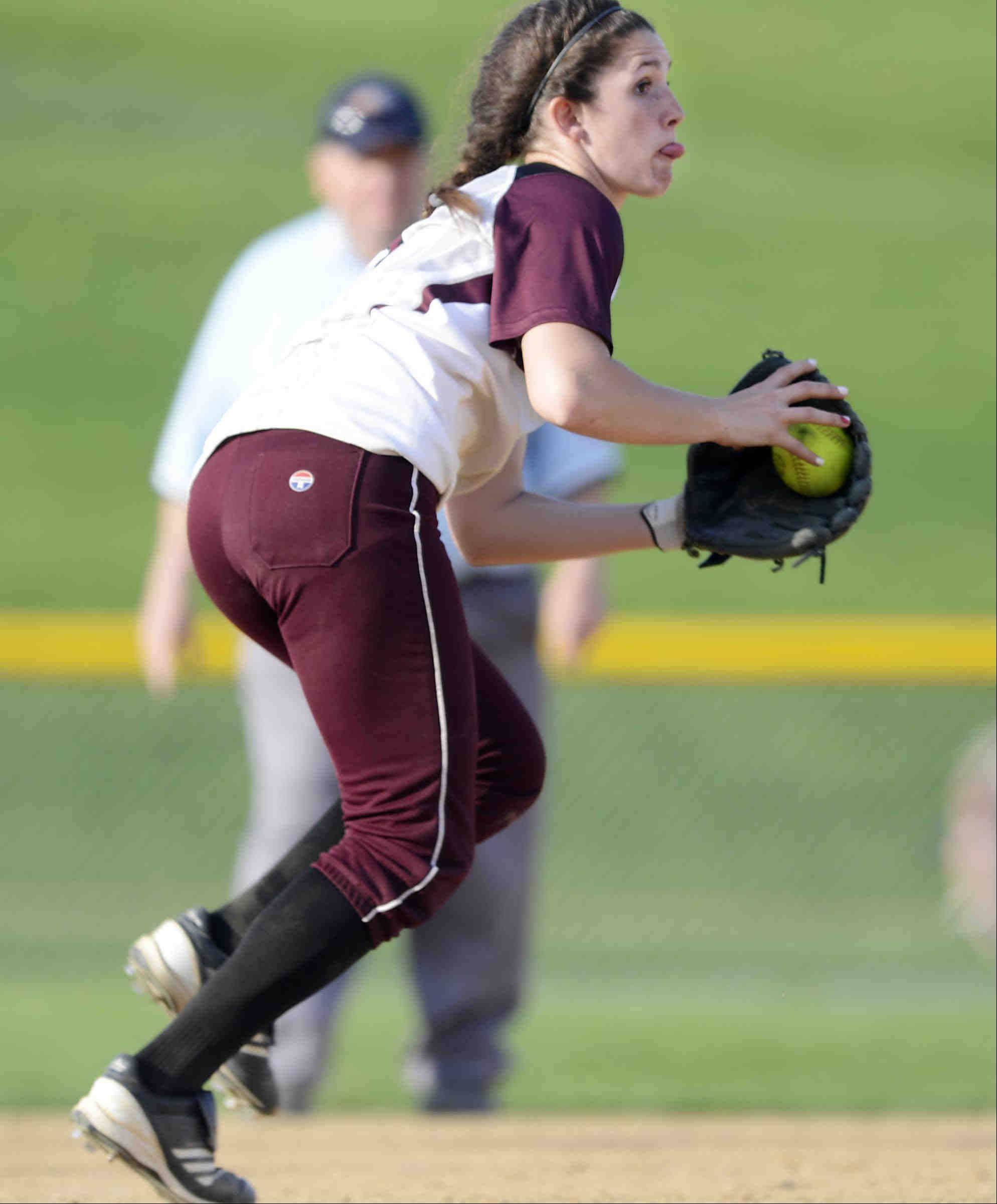 Elgin third baseman Jennah Perryman turns after fielding a bouncing ball by St. Charles North's Alexandra Millett Tuesday in Elgin. Perryman threw her out at first.