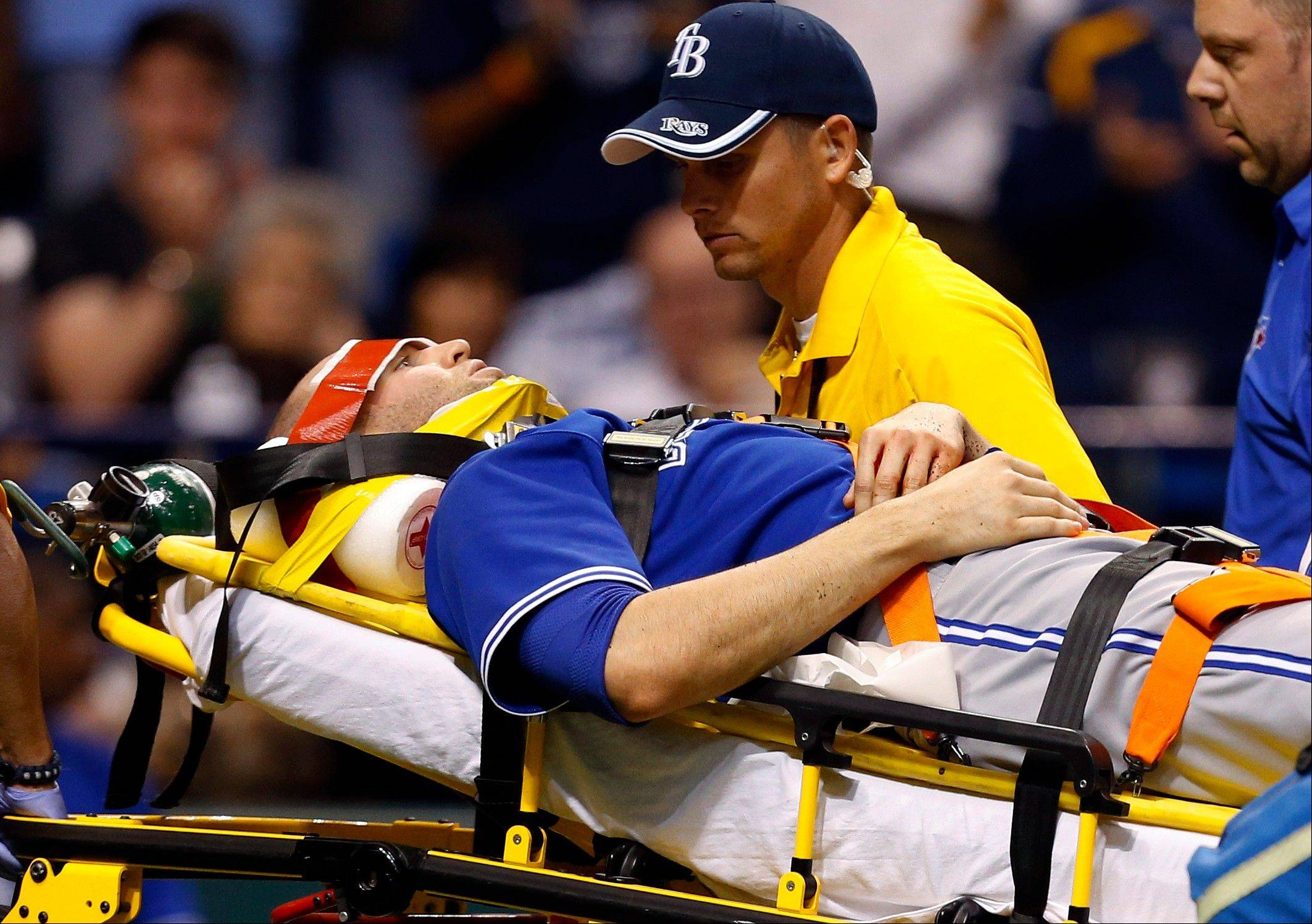 Toronto Blue Jays' J.A. Happ is attended to by medical personnel as he is taken off the field on a stretcher after being hit in the head by a line drive by Tampa Bay Rays' Desmond Jennings during the second inning of a baseball game Tuesday, May 7, 2013, in St. Petersburg, Fla.
