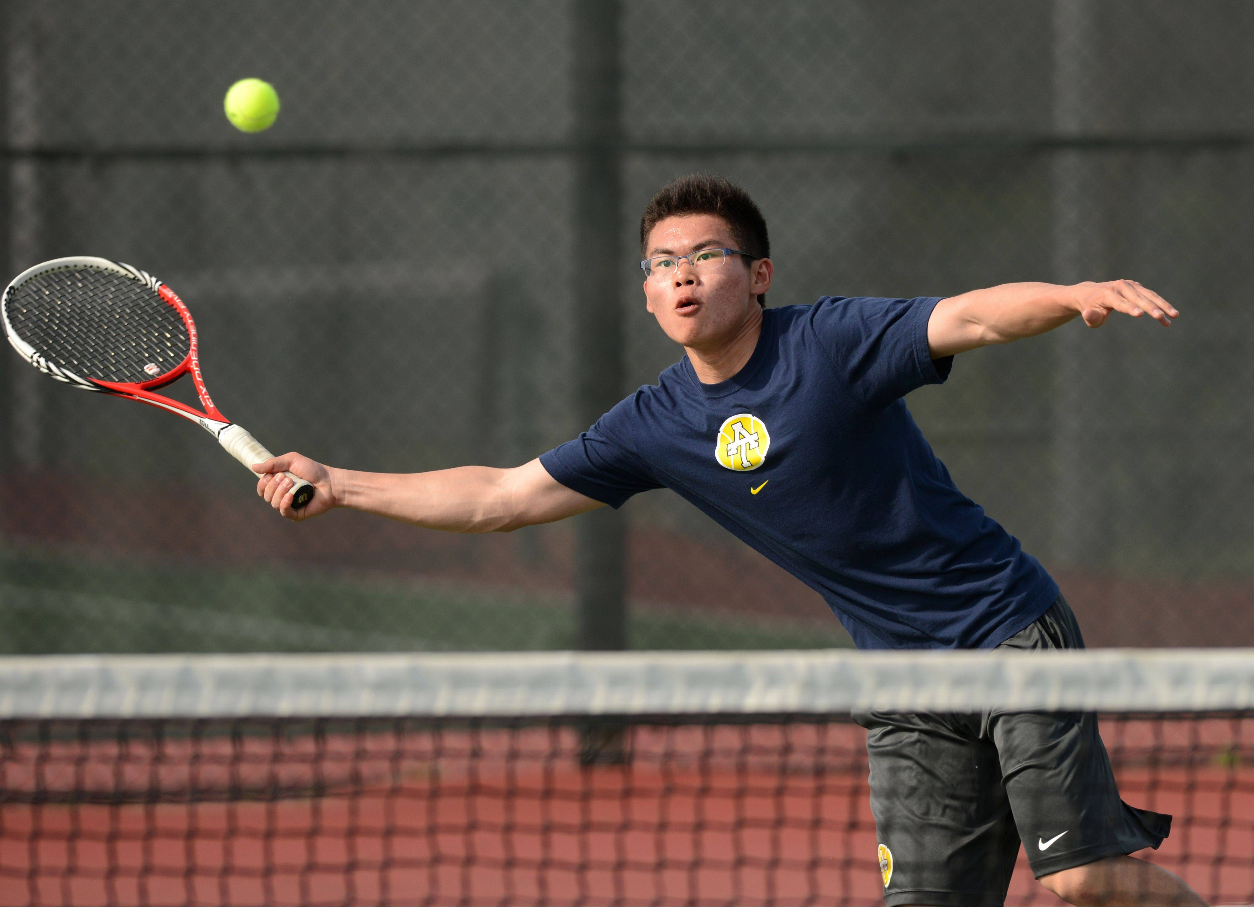 Addison Trail Lan Lin plays against Glenbard South's Brendan Colgan during Monday's varsity boys tennis match in Glen Ellyn.