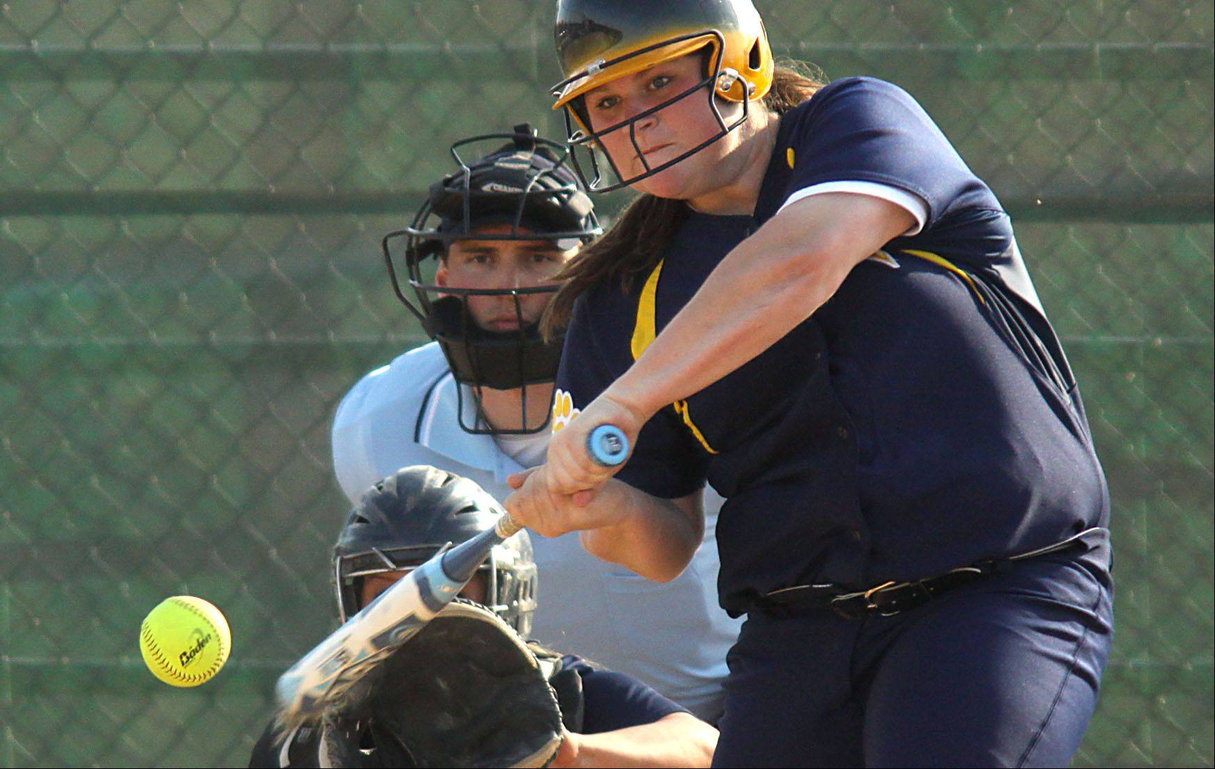 Neuqua Valley's Colleen Hill belts a home run during Wednesday's softball game at South Elgin.
