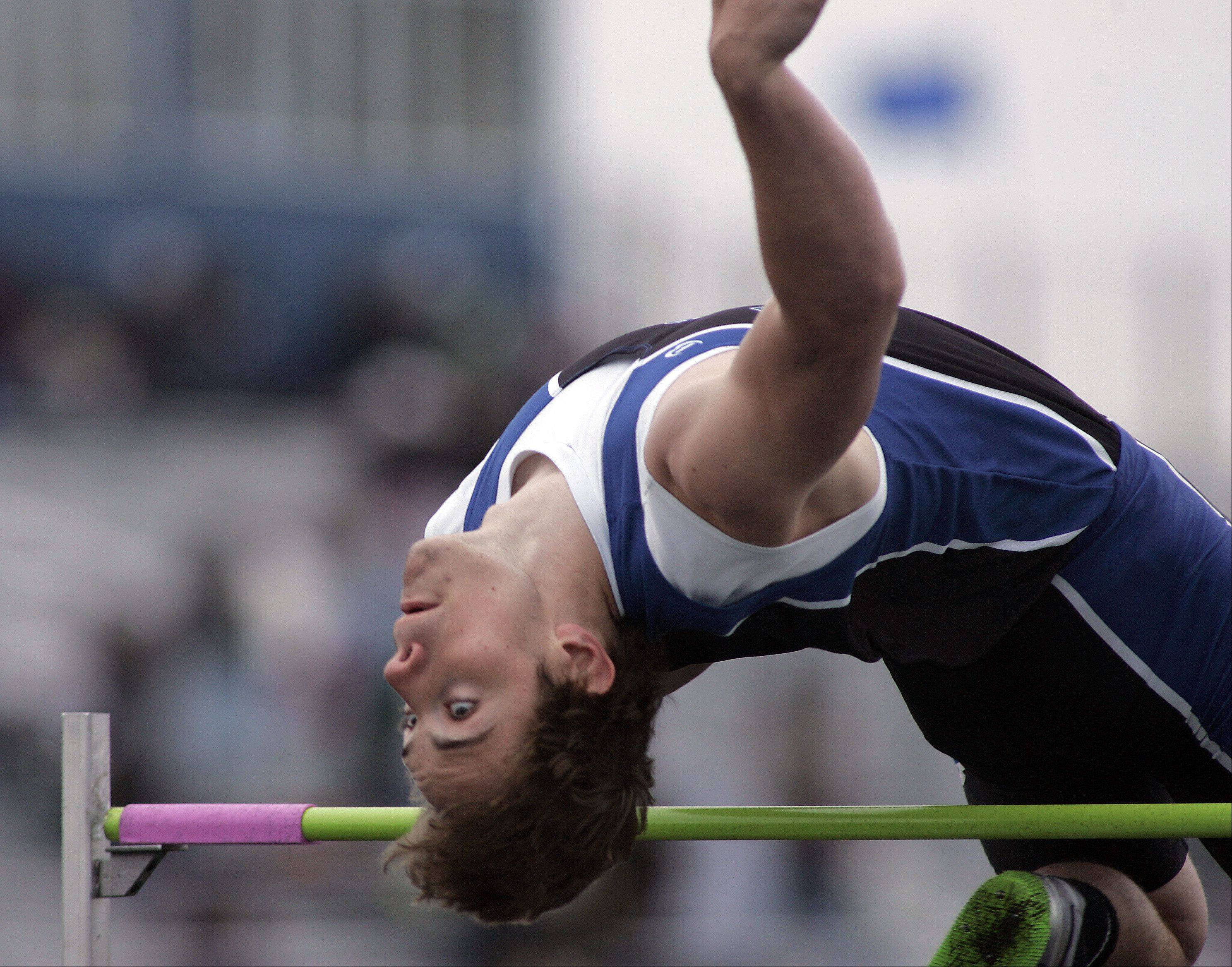 Erik Miller of St. Charles North competes in the high jump during the Kane County boys track meet Friday at Burlington Central High School.