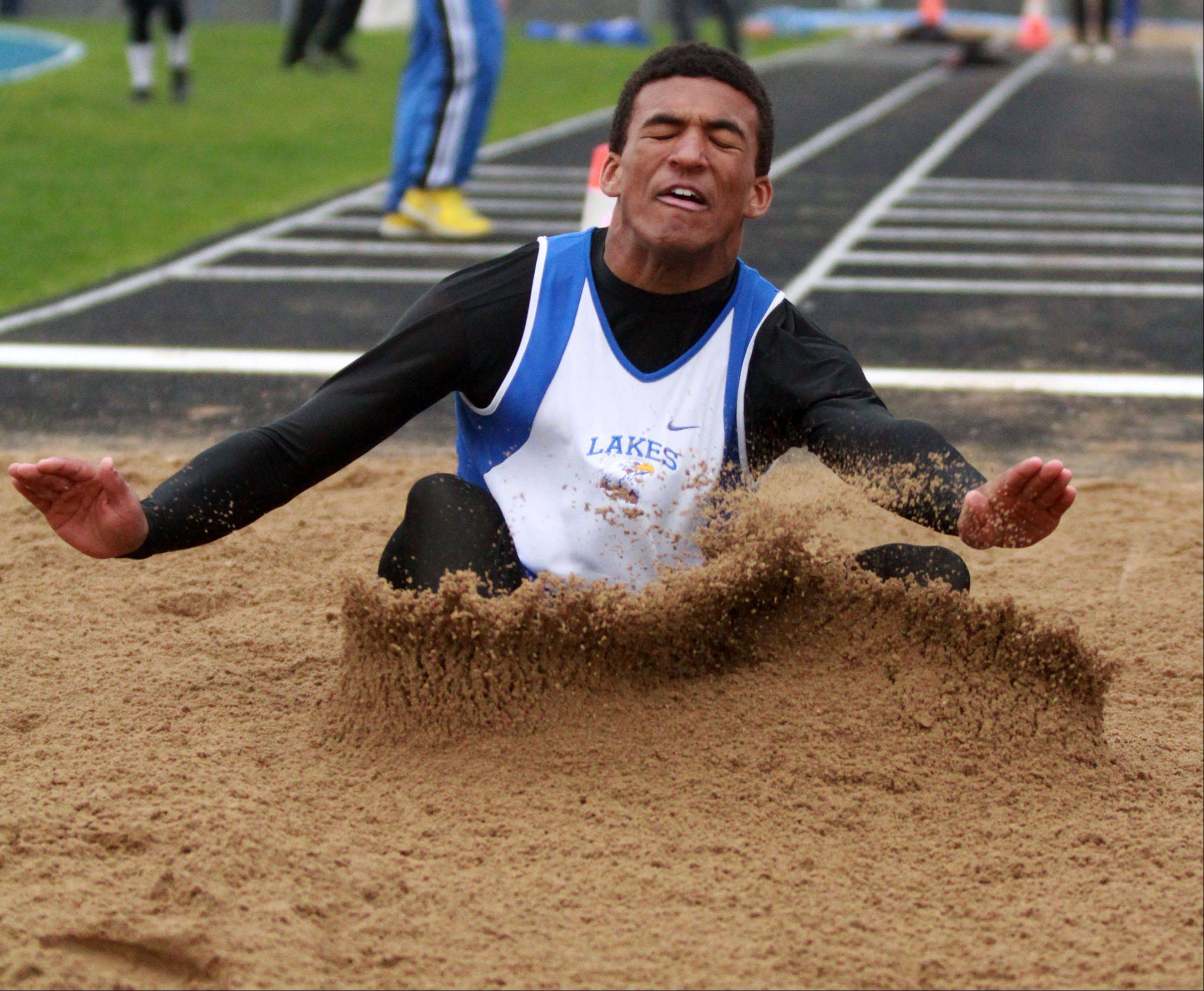 Lakes' Devyn Cedzidlo competes in the long jump in Lake County boys track meet at Lake Zurich on Friday.